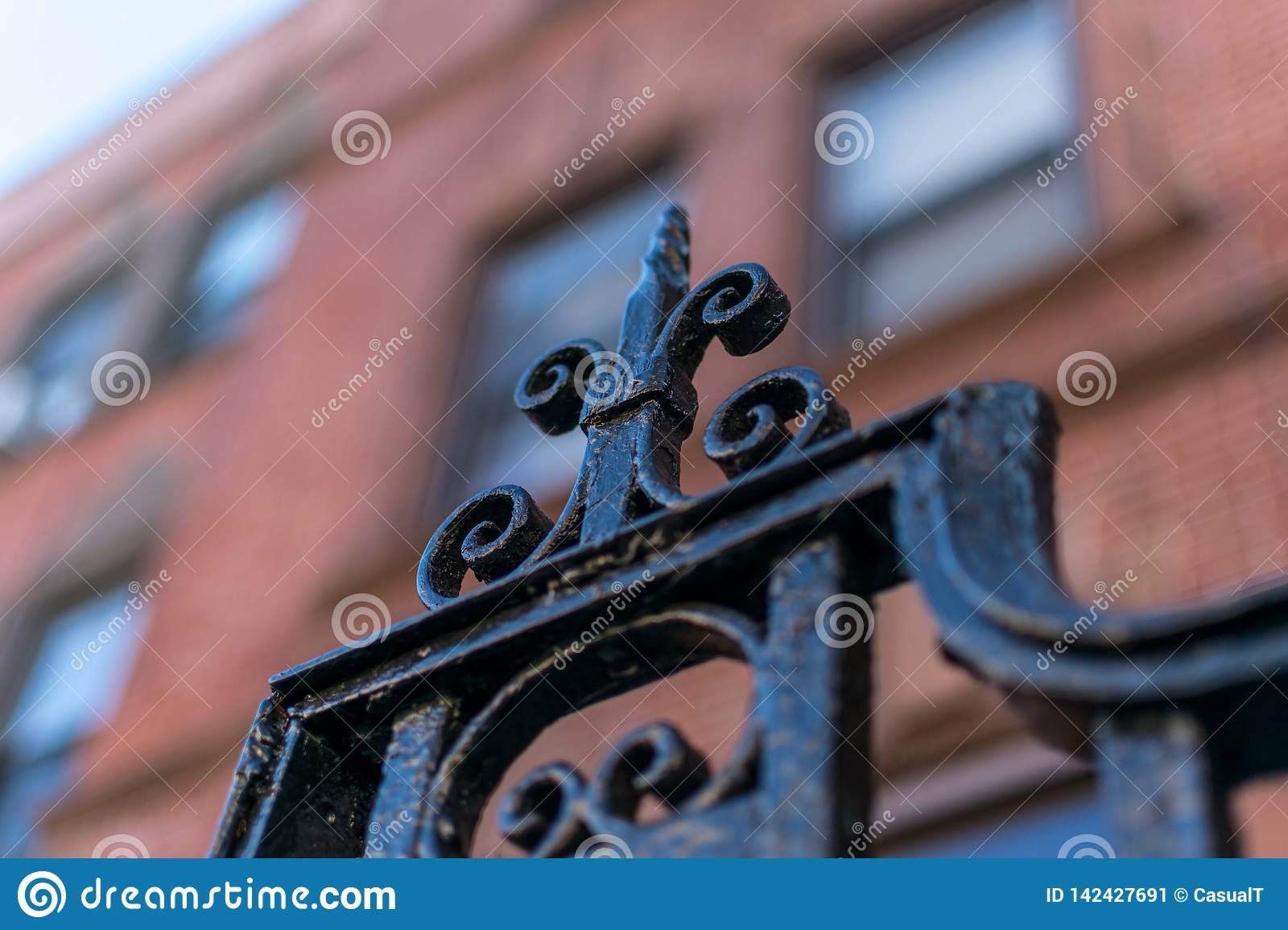 Detail on a wrought iron gate in New York City`s Harlem neighborhood against a bokeh background, Manhattan, NYC, USA