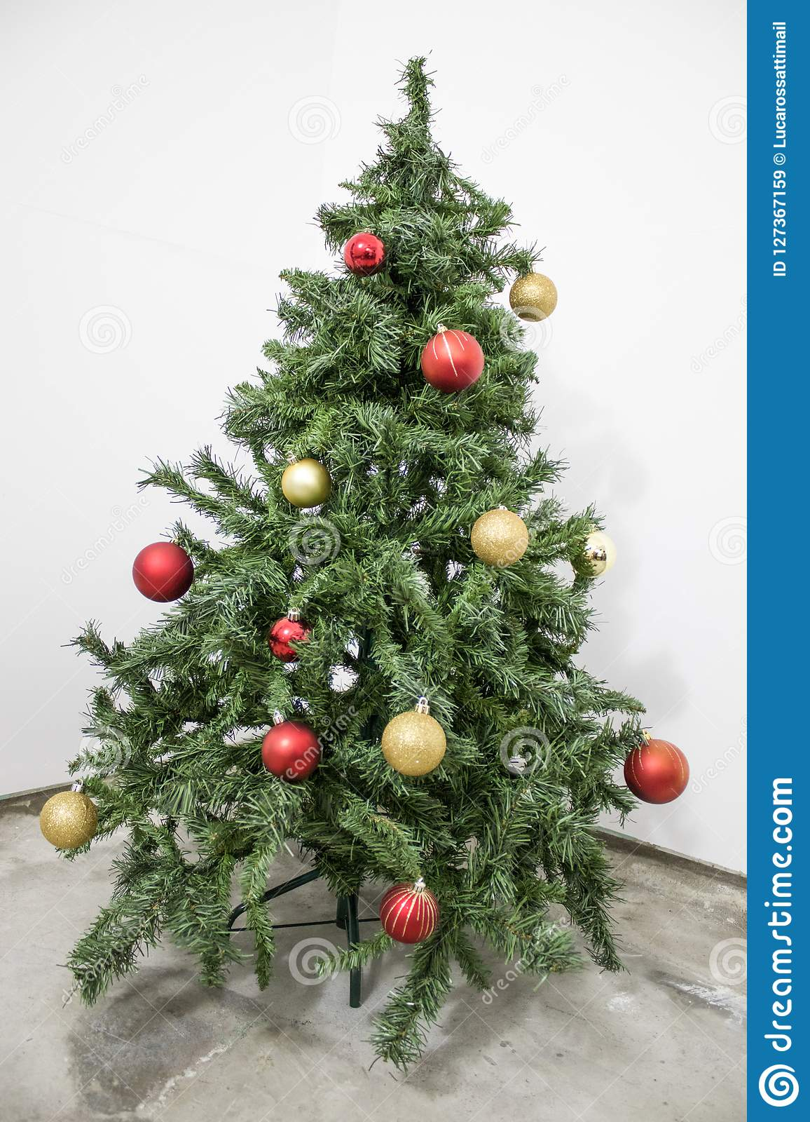 Detailed Green Christmas Tree With Red And Gold Decorations In A Stock Image Image Of Lights Ornament 127367159