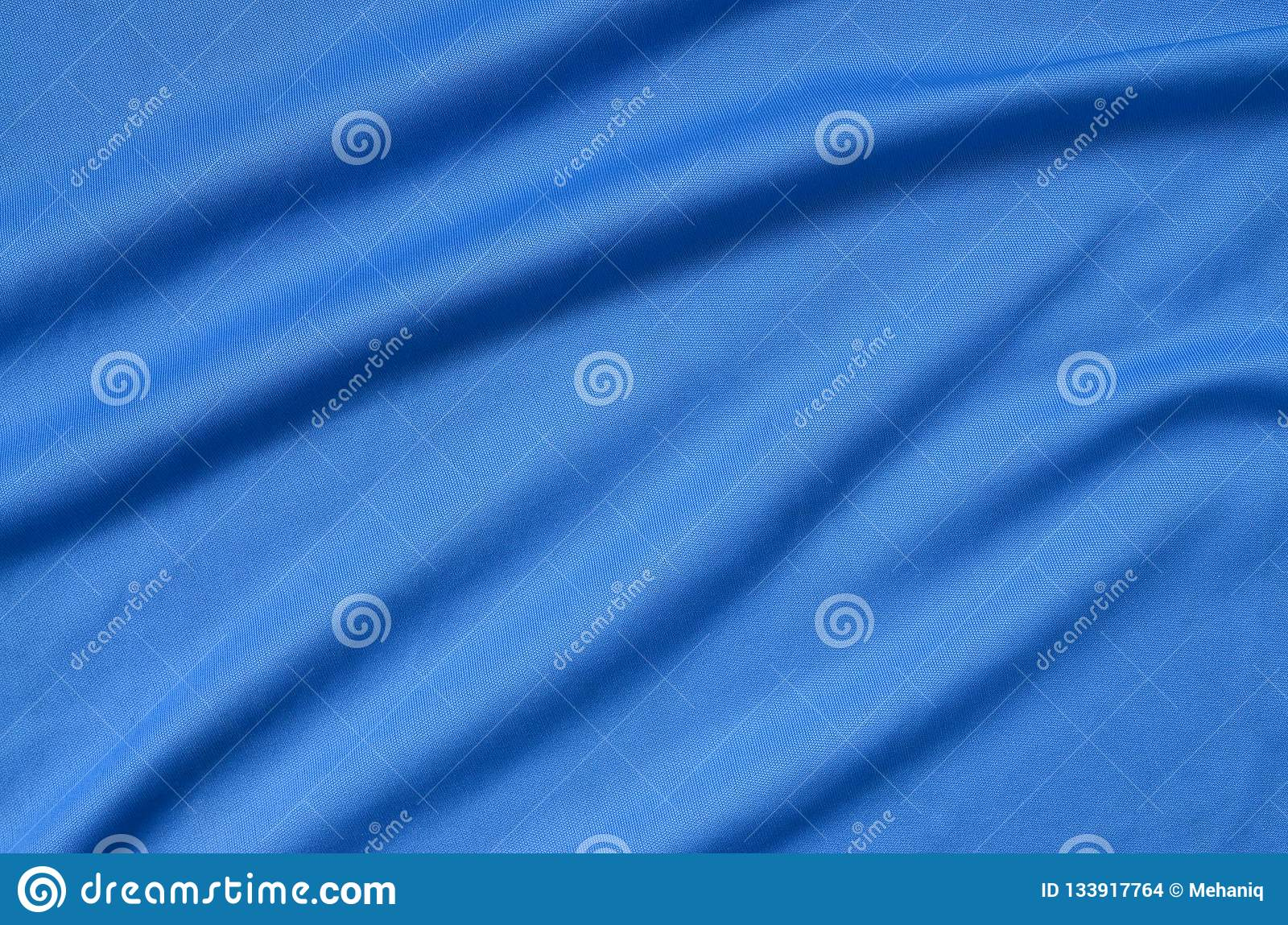 Detailed polyester blue fabric texture with many folds