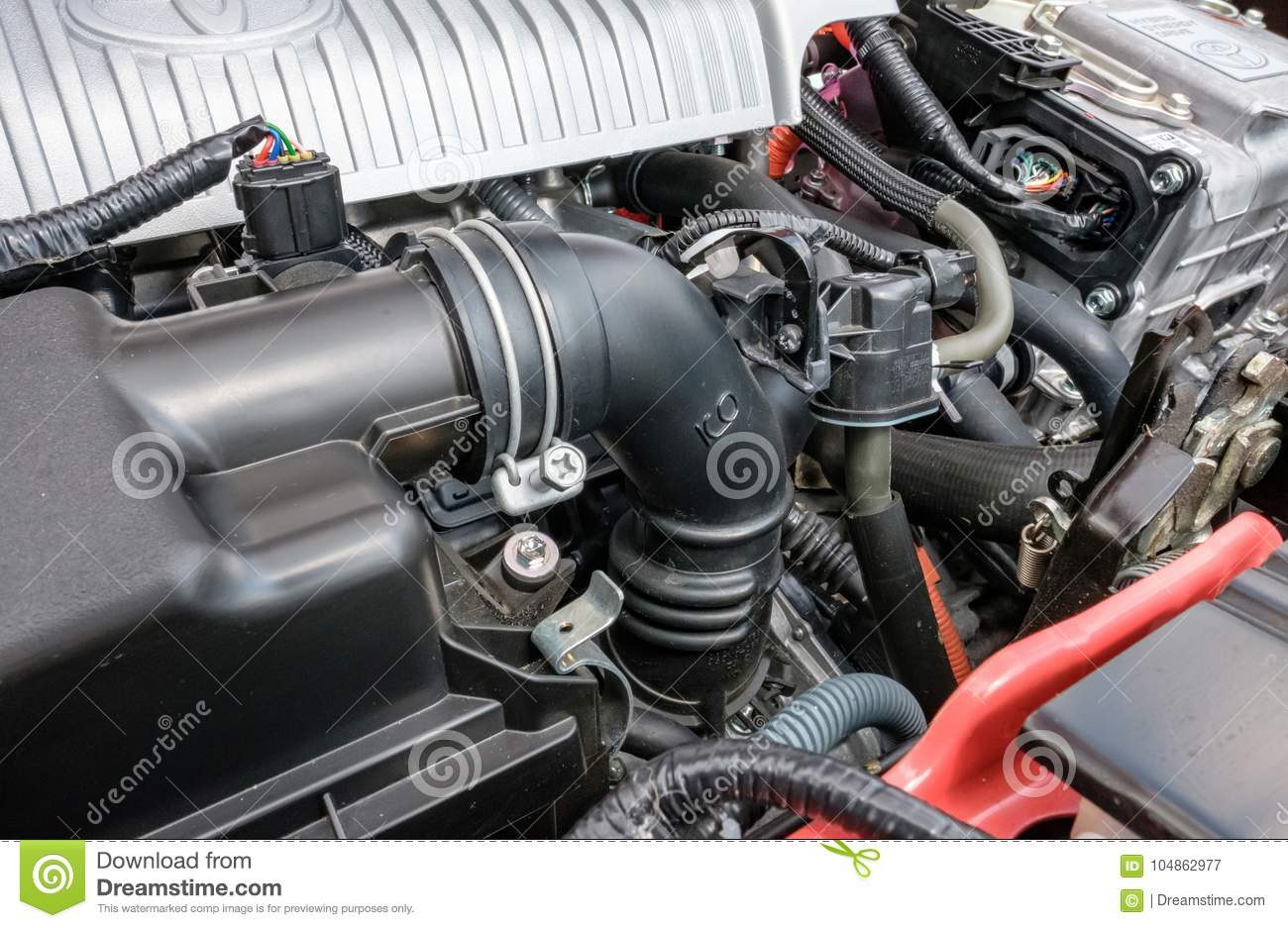 Detailed View Of A Japanese Manufactured Hybrid Car Engine, Showing ...