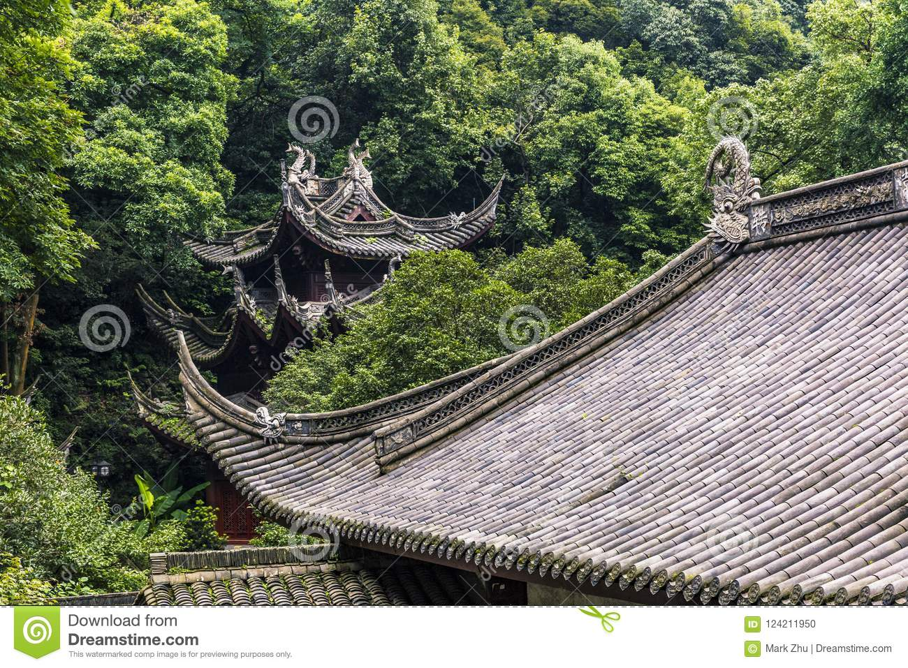 details of chinese architecture surrounded by trees stock photo