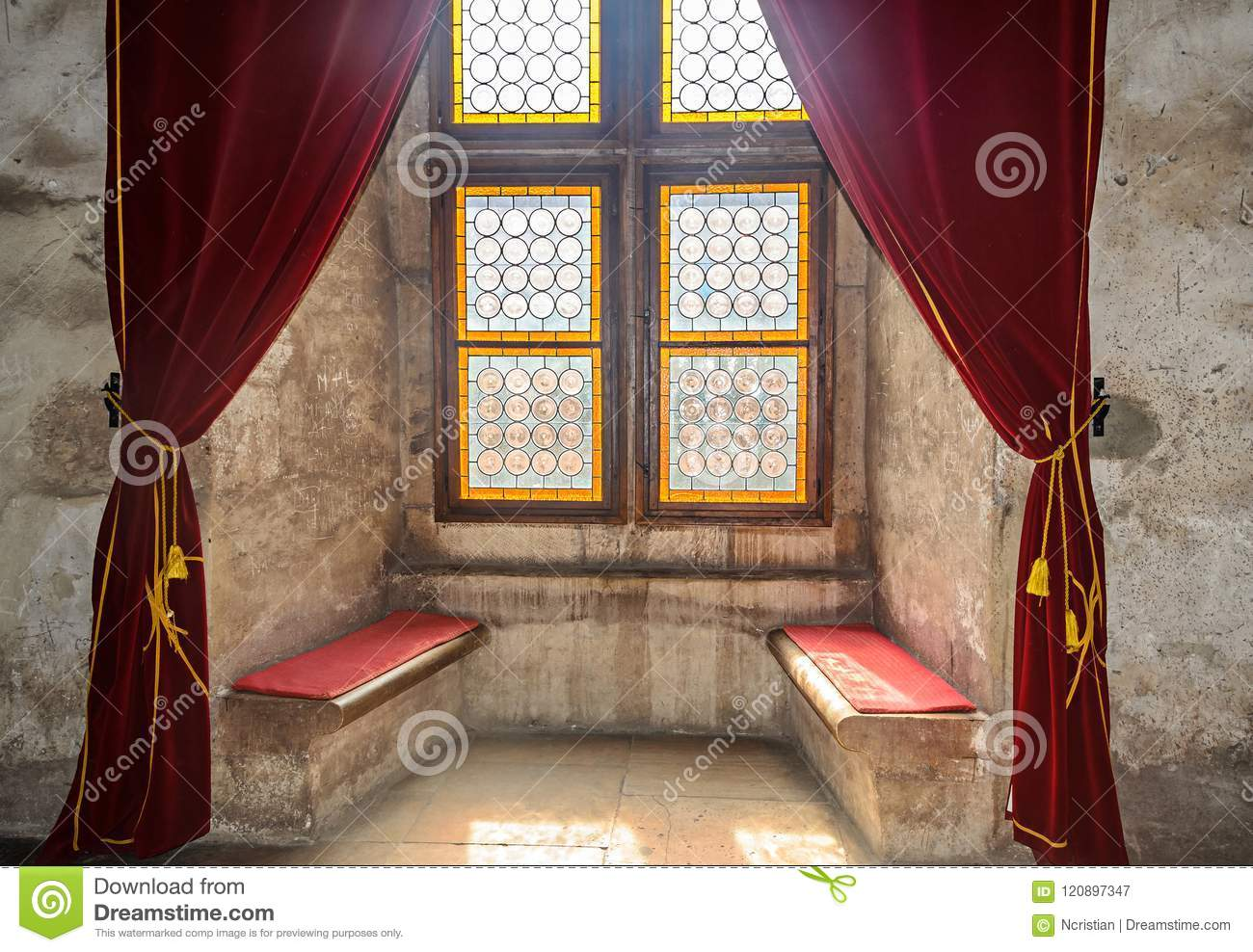 Details from the interior room of the Corvins Castle build by John Hunyadi, colored window.
