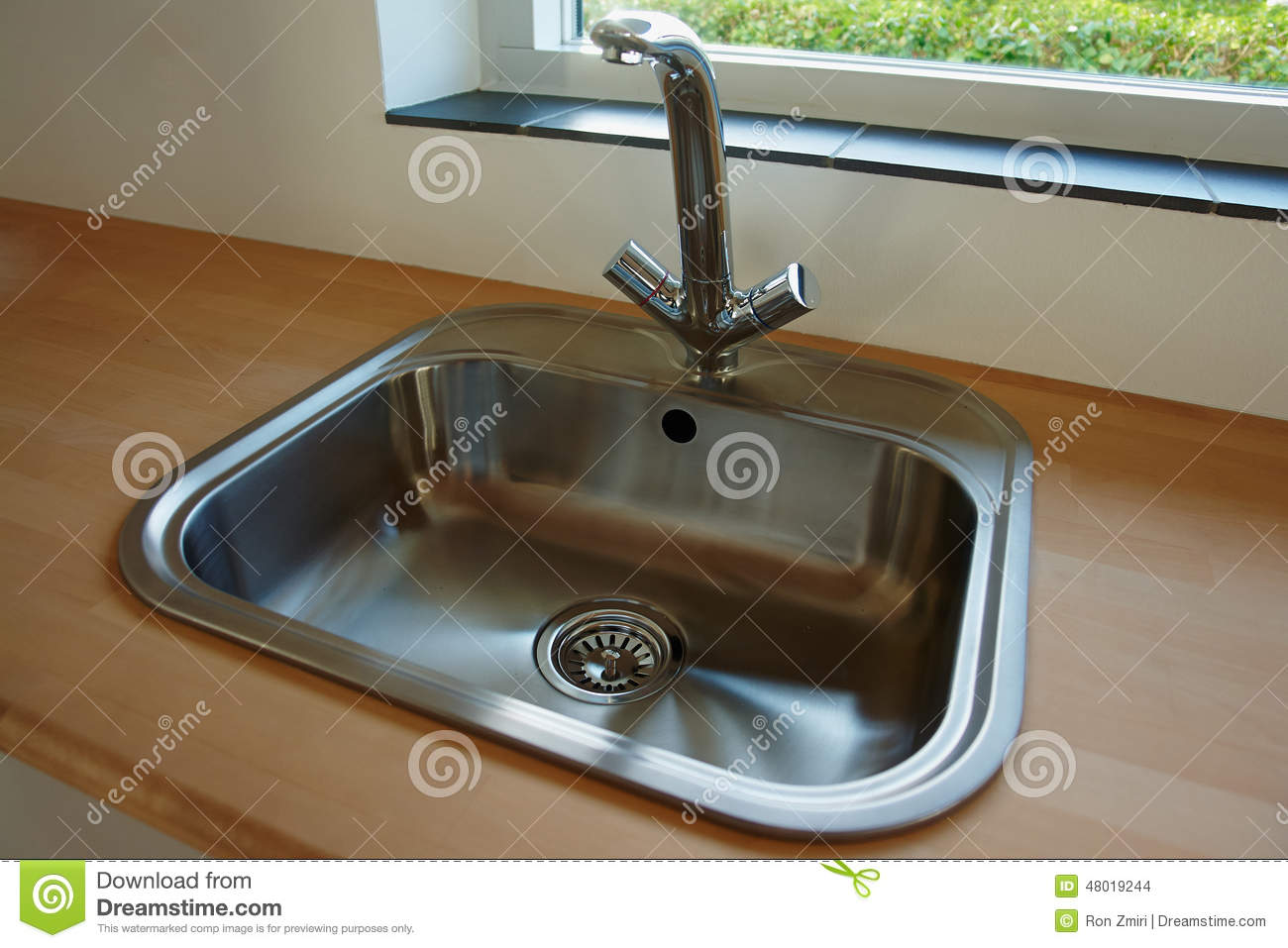 details of modern kitchen sink with tap faucet stock photo image
