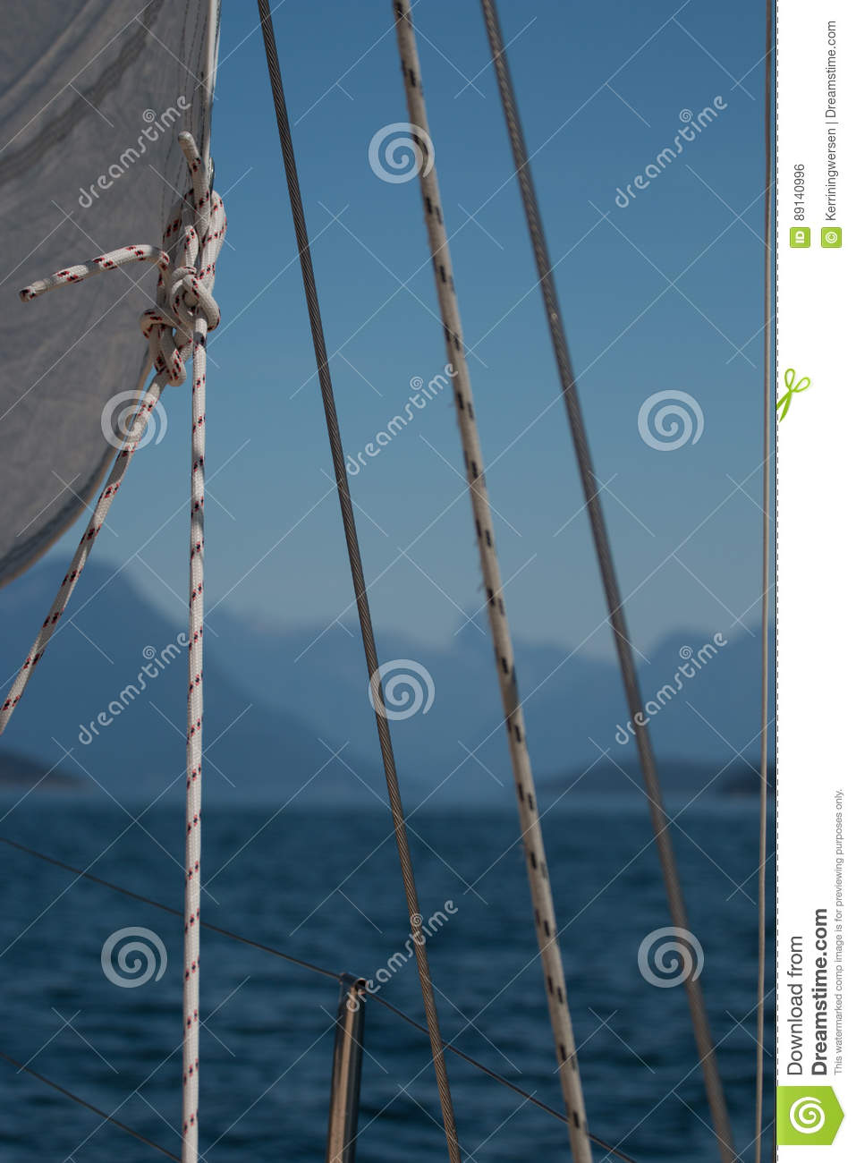 details of a sailboat white sail lifelines and sheets before