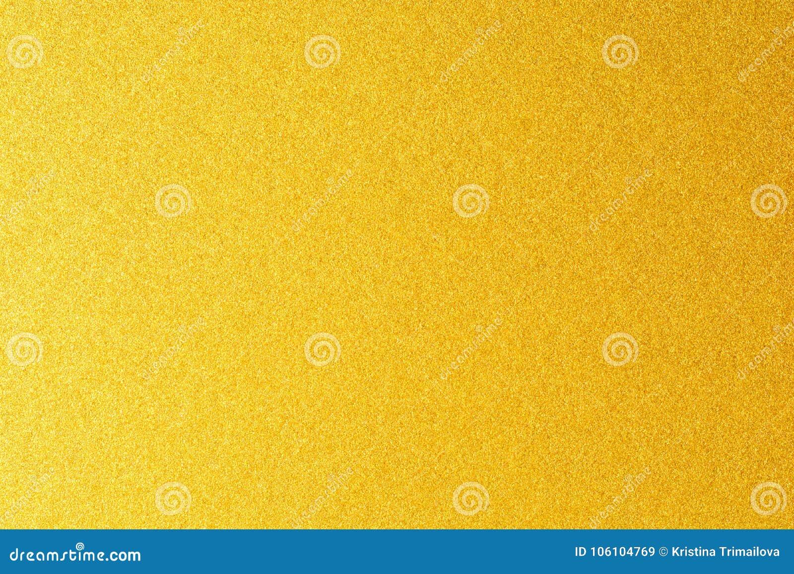 Detalhes de fundo dourado da textura Parede da pintura da cor do ouro Fundo e papel de parede dourados luxuosos Folha de ouro ou