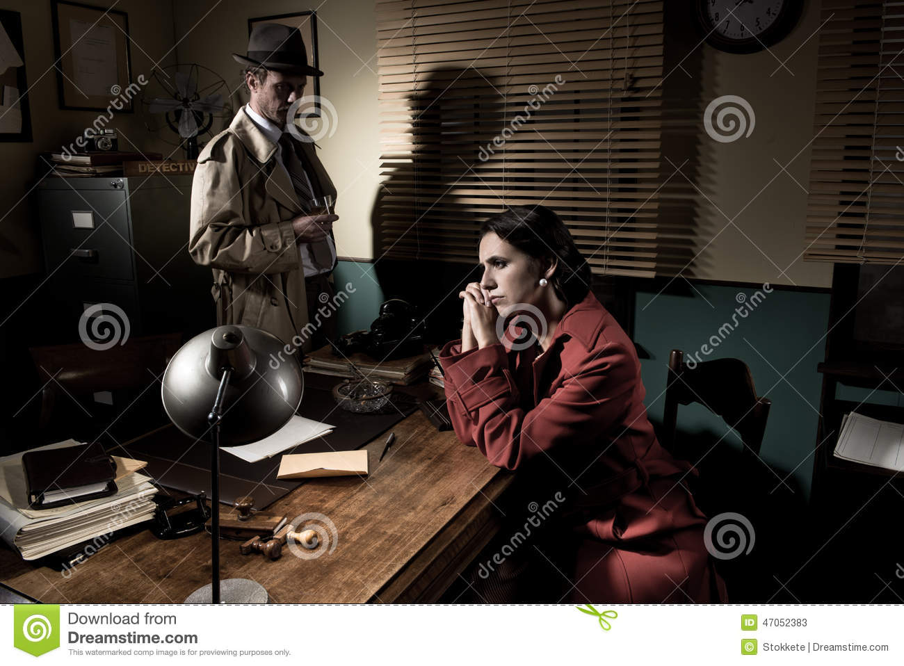 Detective interviewing a young pensive woman in his office