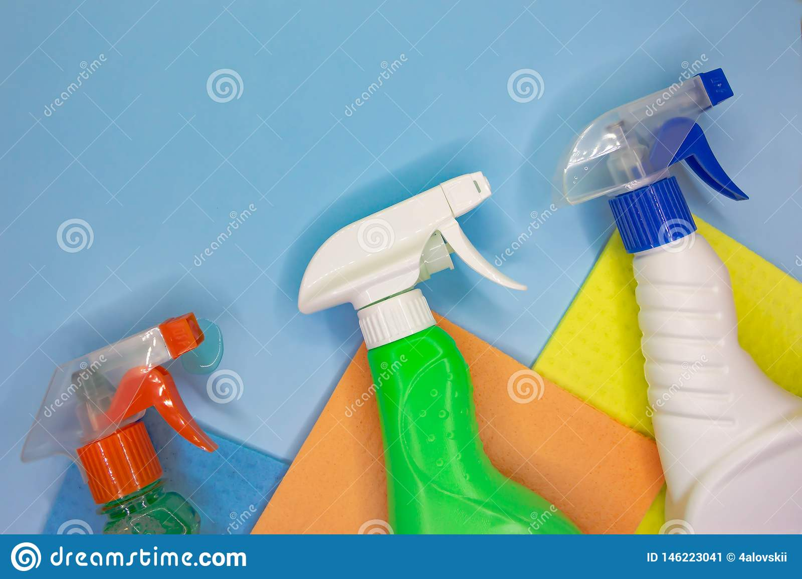 Detergents and cleaning accessories in blue color. Cleaning service, small business idea
