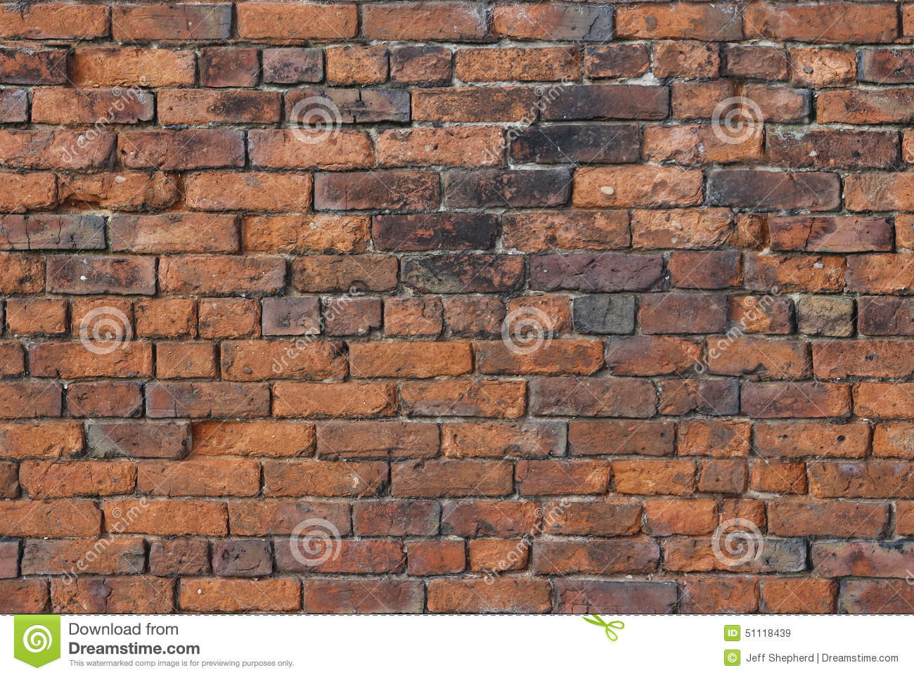 A deteriorating old brick wall could be use a background for Uses for a brick