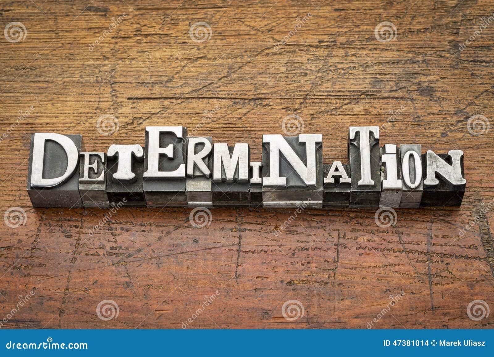 Determination word in mixed vintage metal type printing blocks over ...