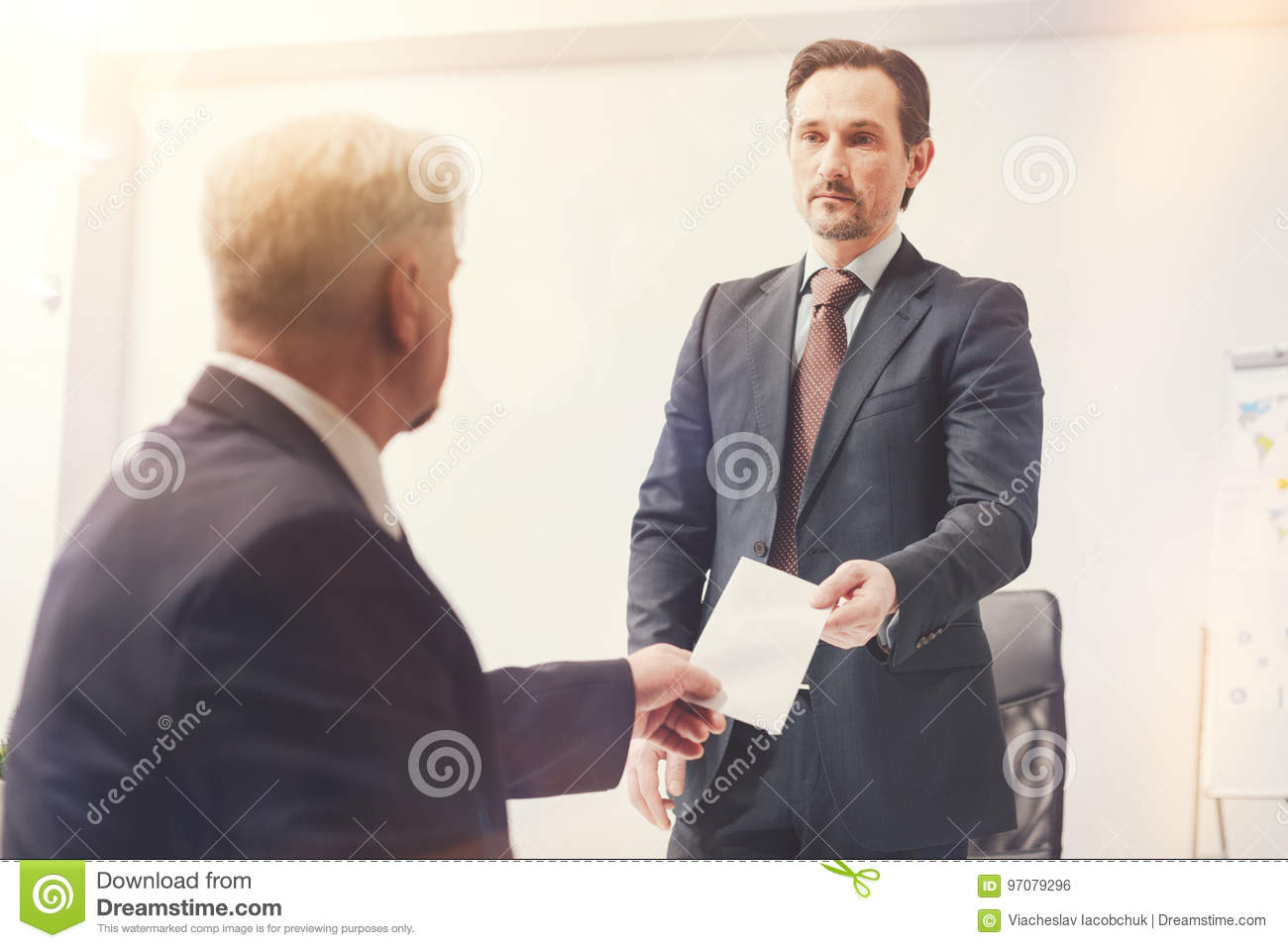 determined ambitious man submitting his letter of resignation stock