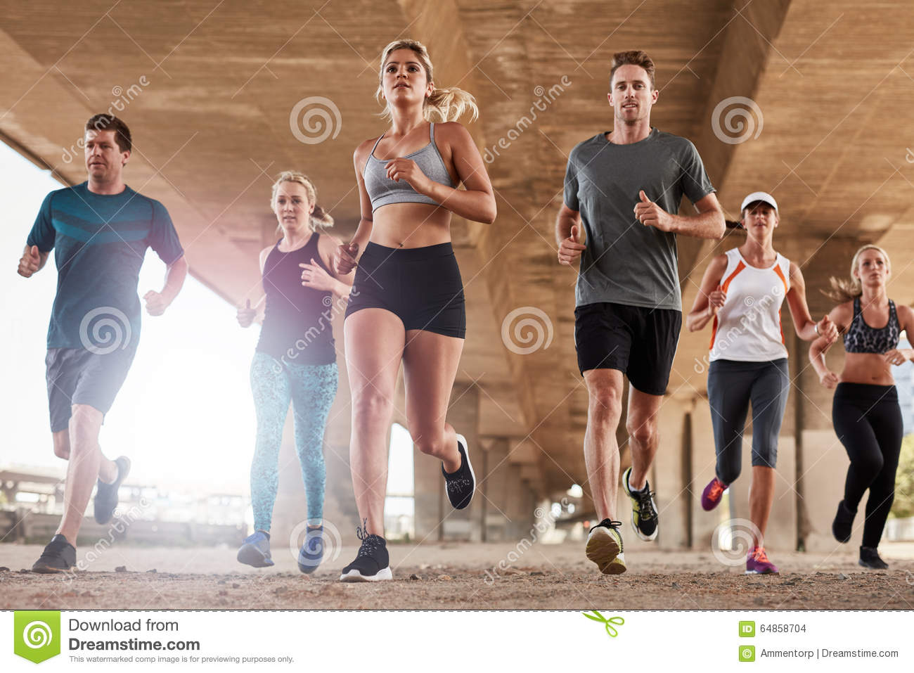 Determined group of young people running in city