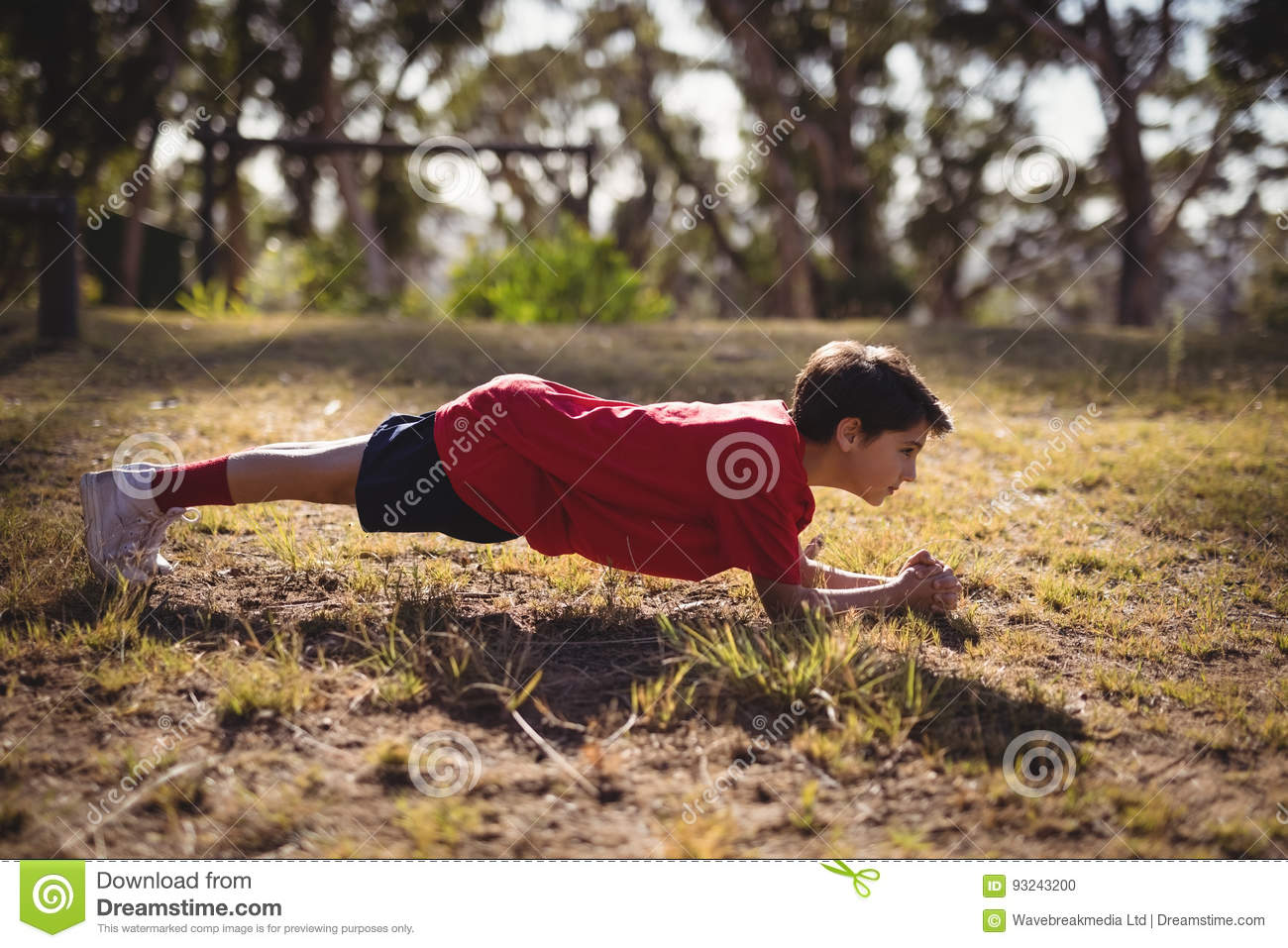 Determined kid exercising during obstacle course