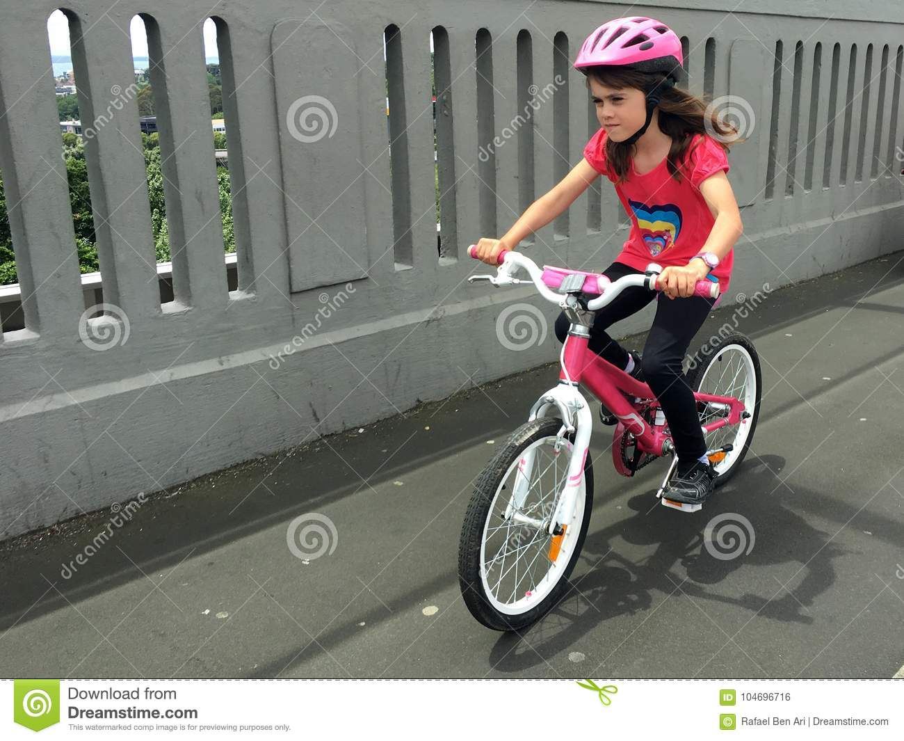 Determined young girl rides a bike