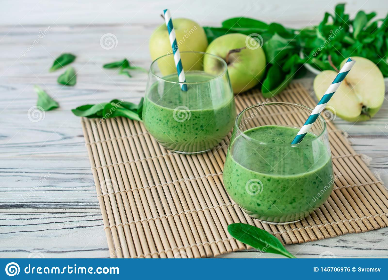 Detox fresh green smoothie with spinach, apple, mache lamb lettuce