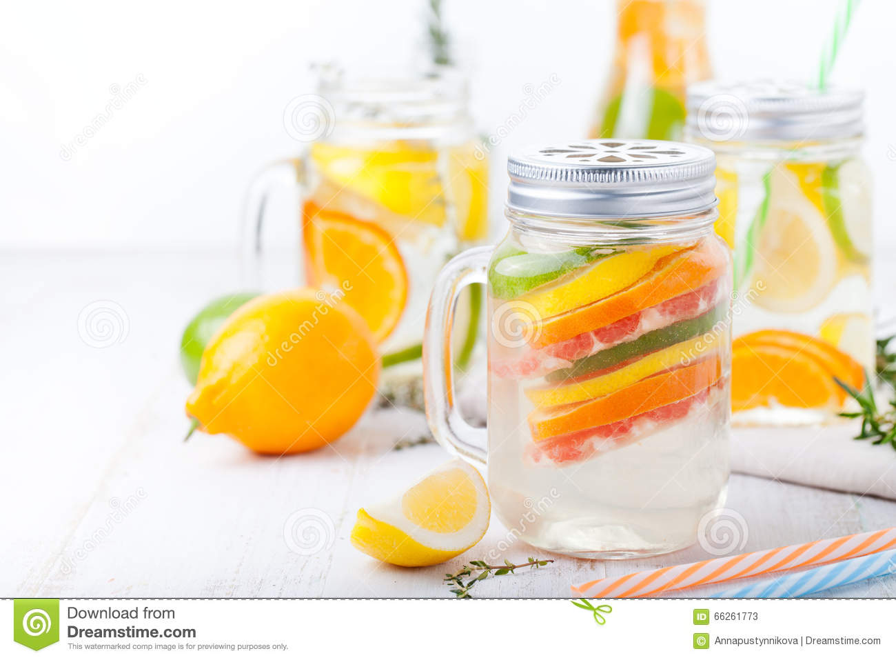 Detox fruit infused flavored water. Refreshing summer homemade lemonade cocktail Cleanse body and burn fat