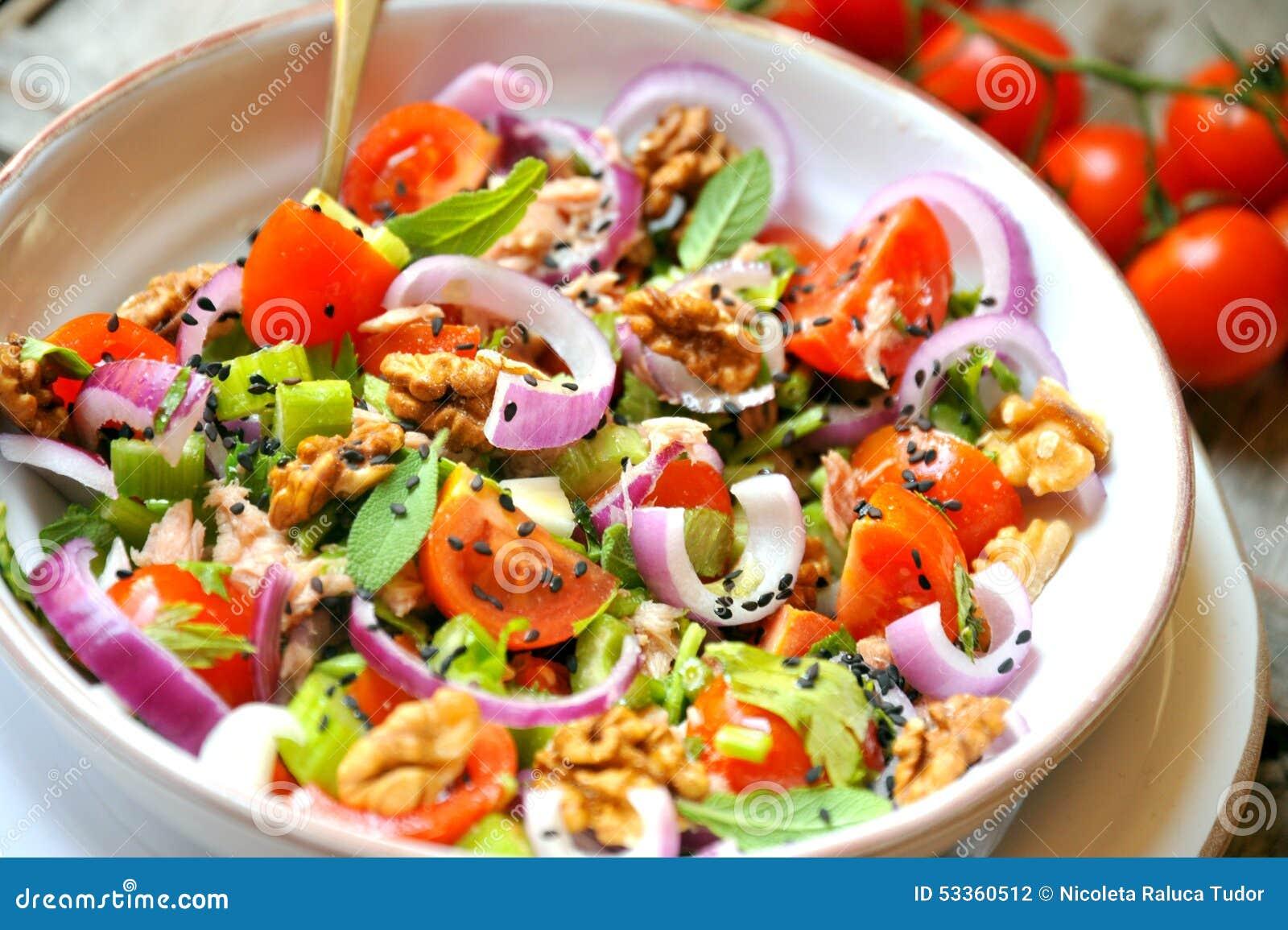 Detox , veggie, raw salad with tomato, onions and walnuts