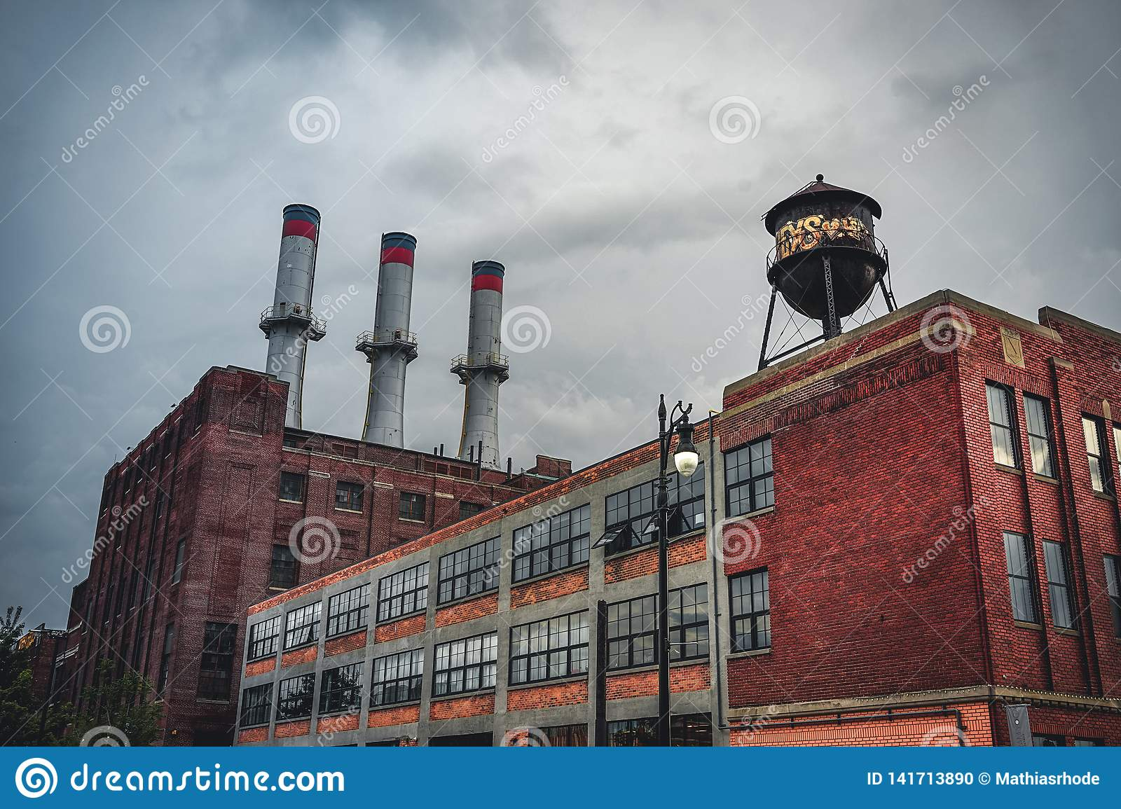 Detroit, Michigan, May 18, 2018: View towards typical Detroit Automotive Factory with water tower and Chimney.