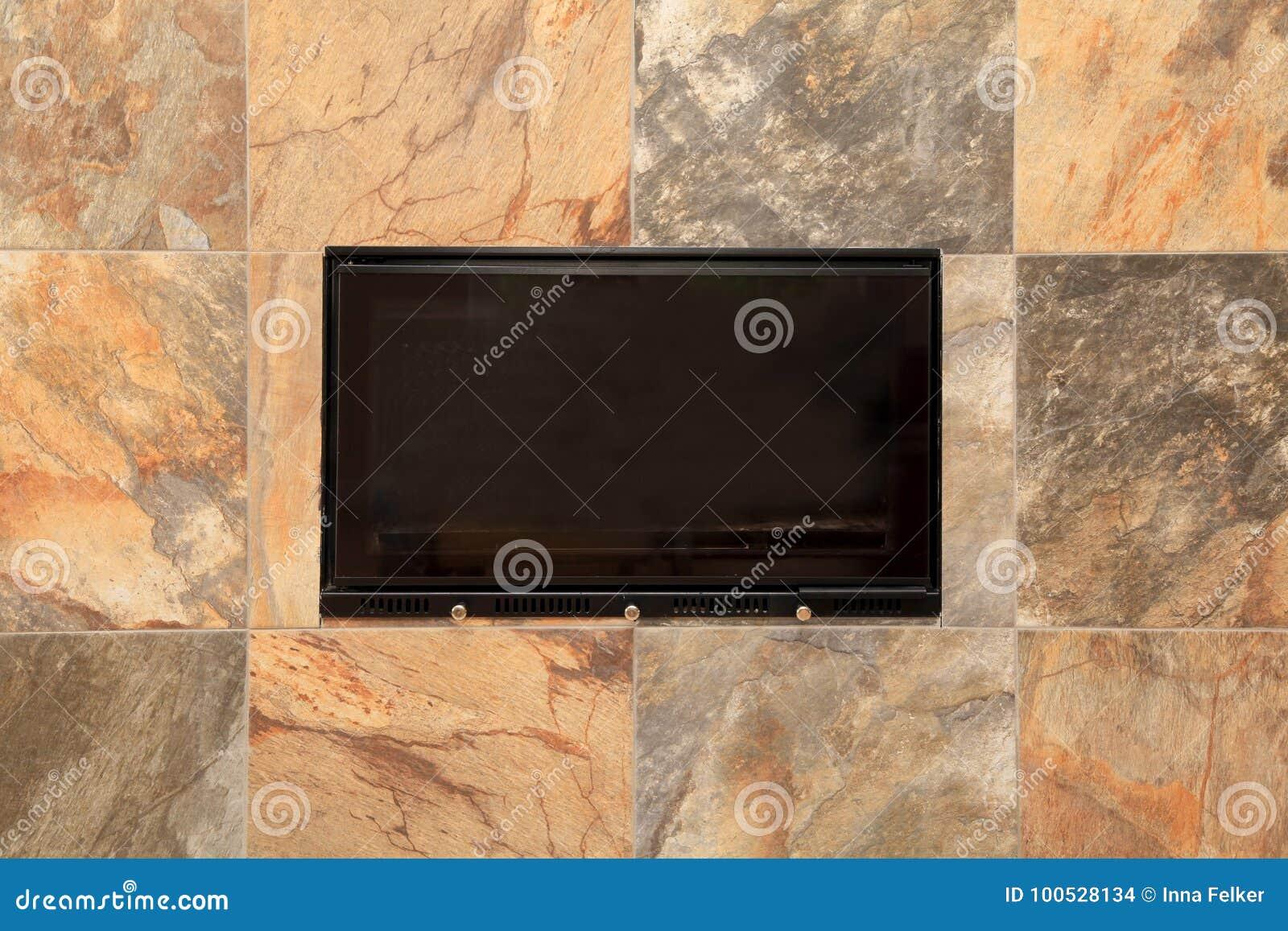 Dettaglio di pietra del camino delle mattonelle