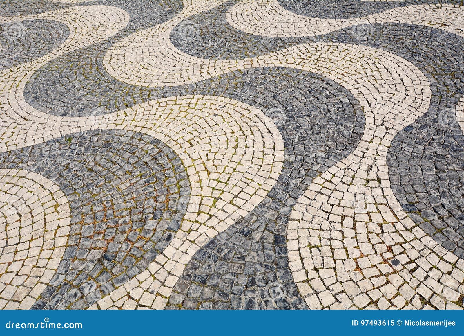 Dettaglio di una pavimentazione del ciottolo - Lisbona, Portogallo