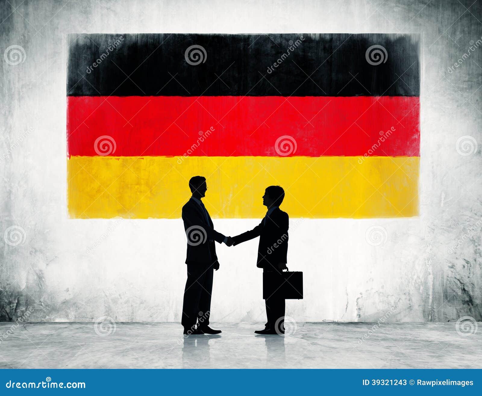 Deutsche Flagge mit zwei Geschäftsmännern