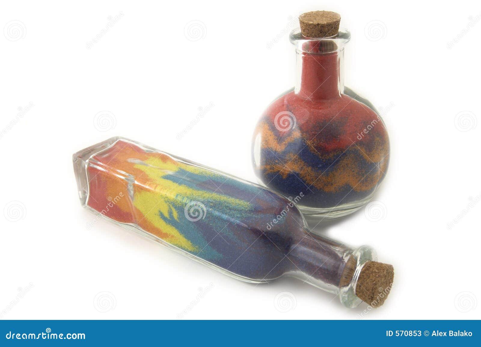 deux bouteilles avec le sable color photos stock image 570853. Black Bedroom Furniture Sets. Home Design Ideas