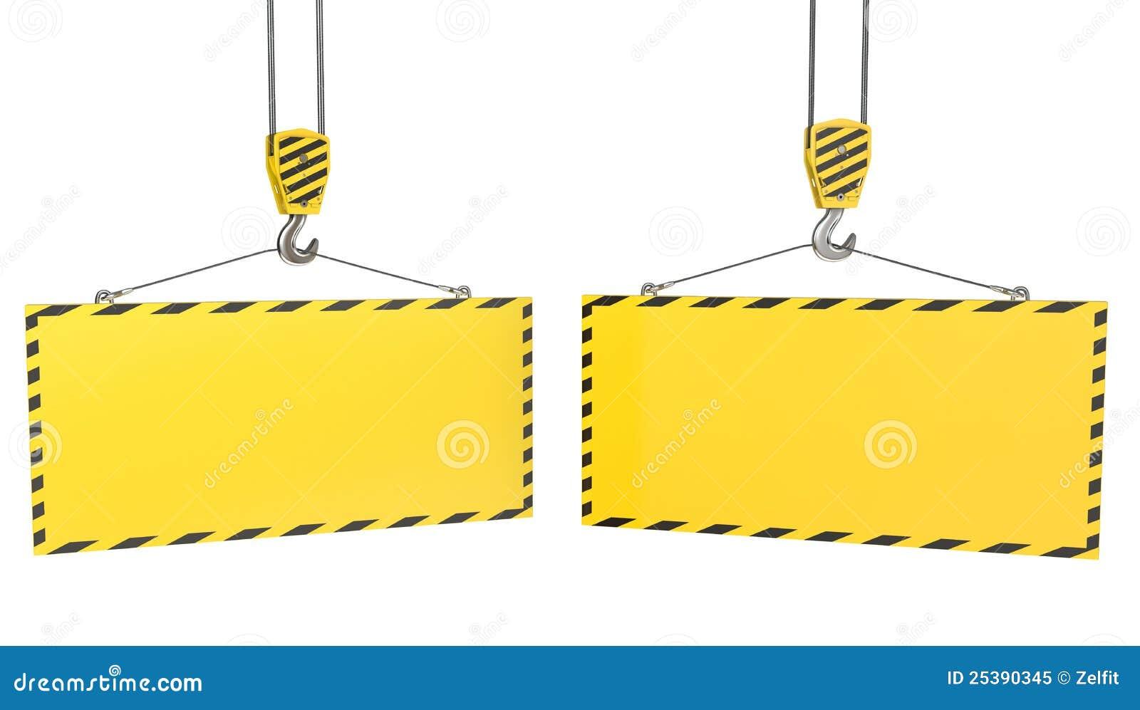 Deux crochets de grue avec les plaques jaunes blanc