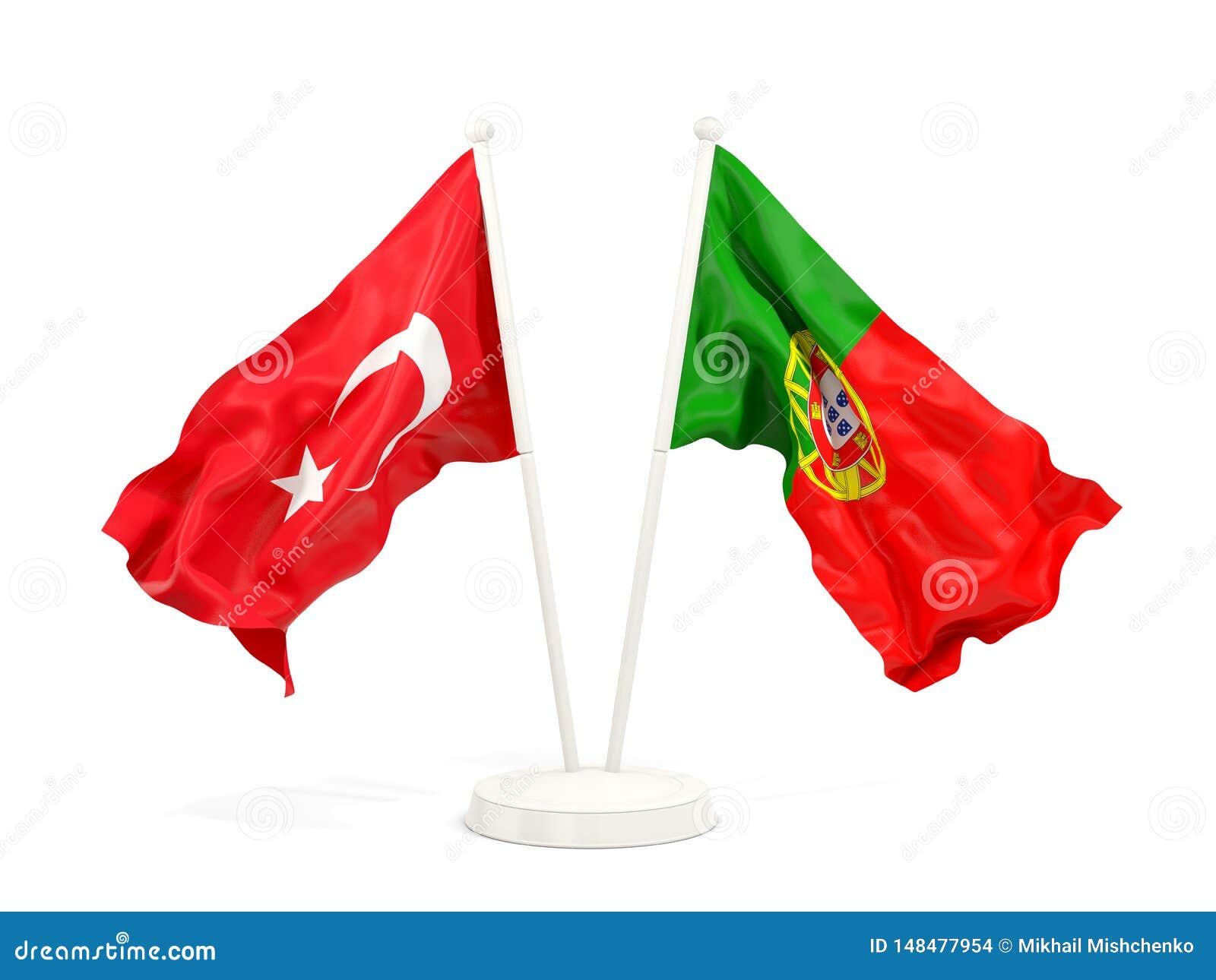 Deux drapeaux de ondulation de la Turquie et du Portugal d isolement sur le blanc