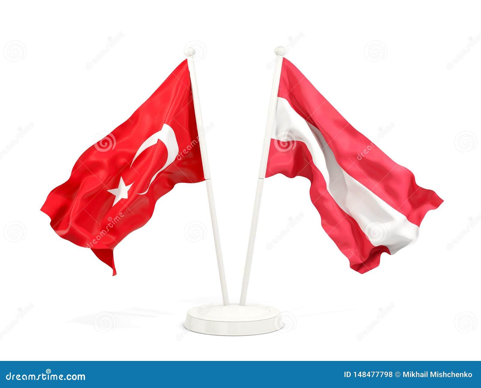 Deux drapeaux de ondulation de la Turquie et de l Autriche d isolement sur le blanc