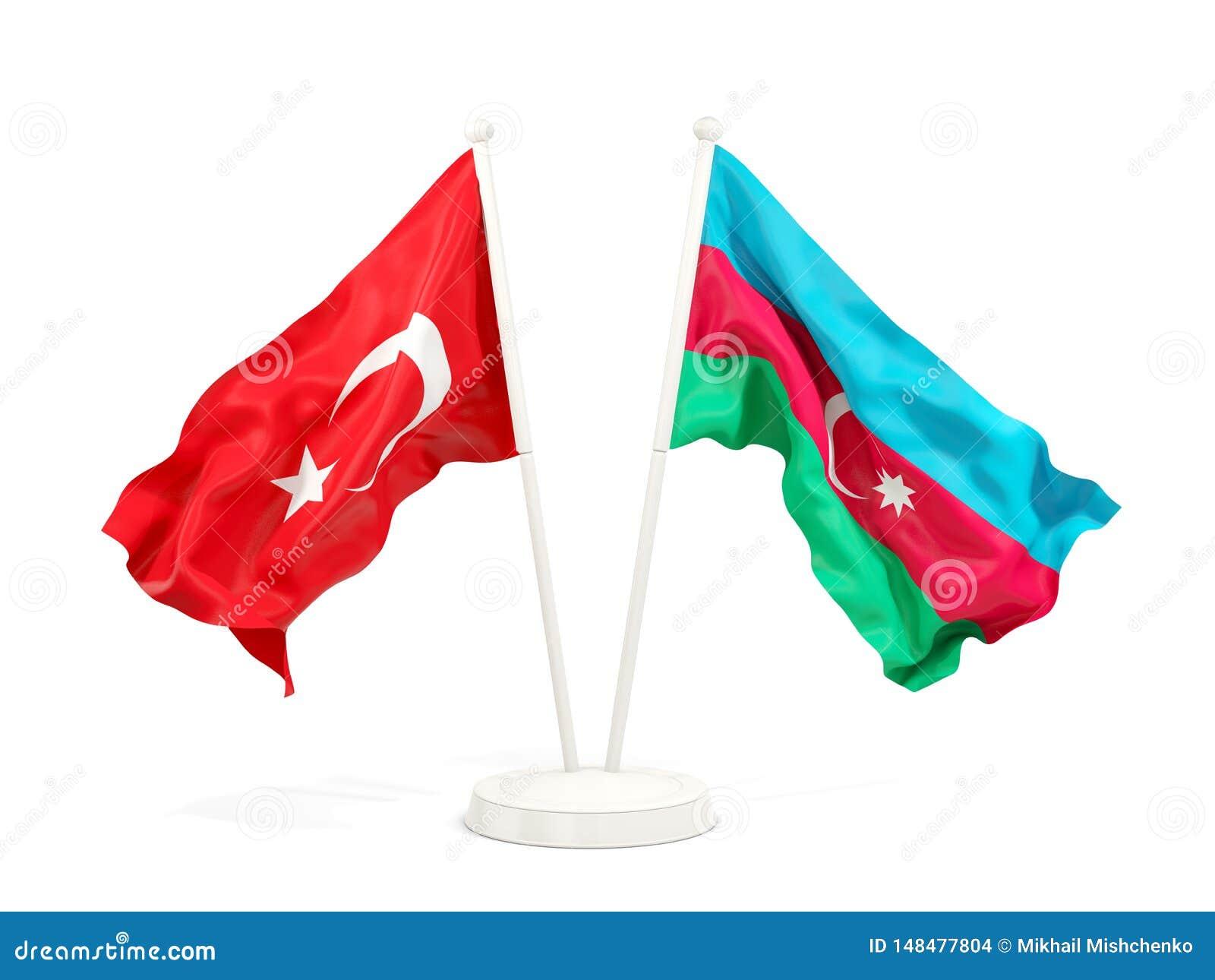Deux drapeaux de ondulation de la Turquie et de l Azerba?djan d isolement sur le blanc