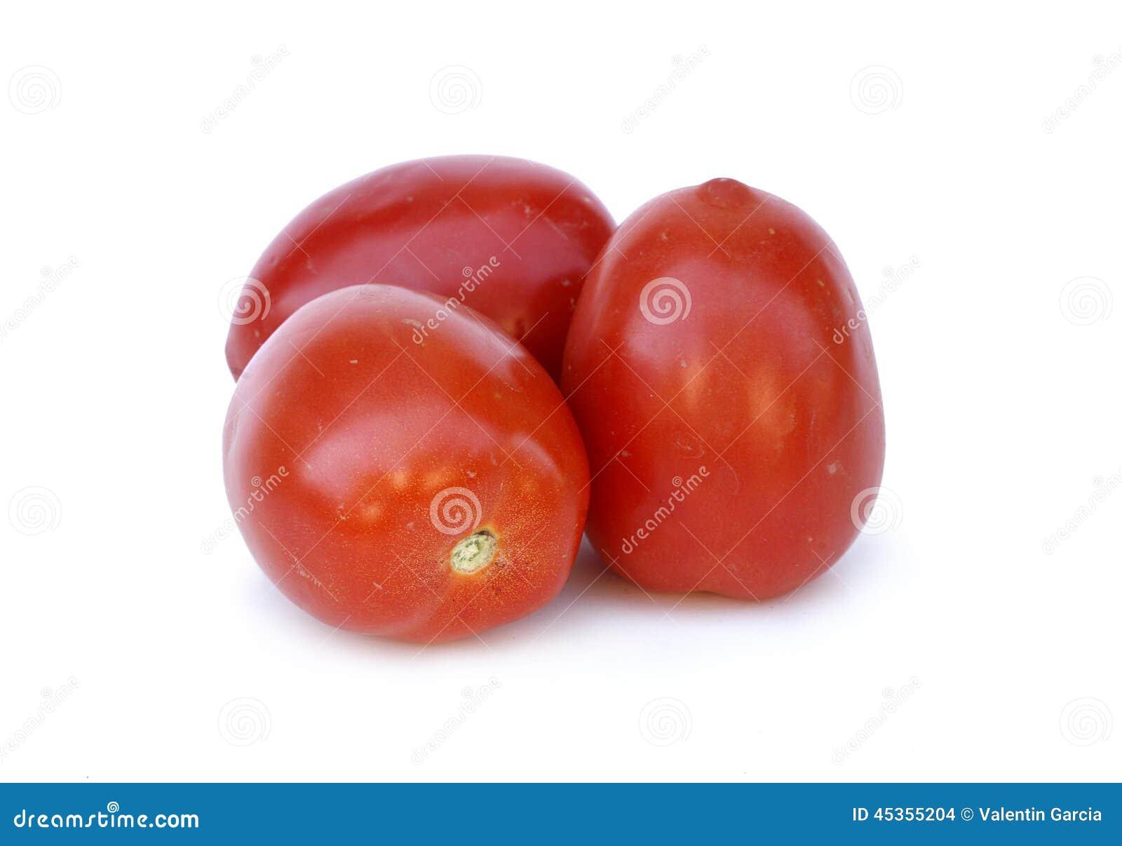 Deux tomates rouges sur le fond blanc