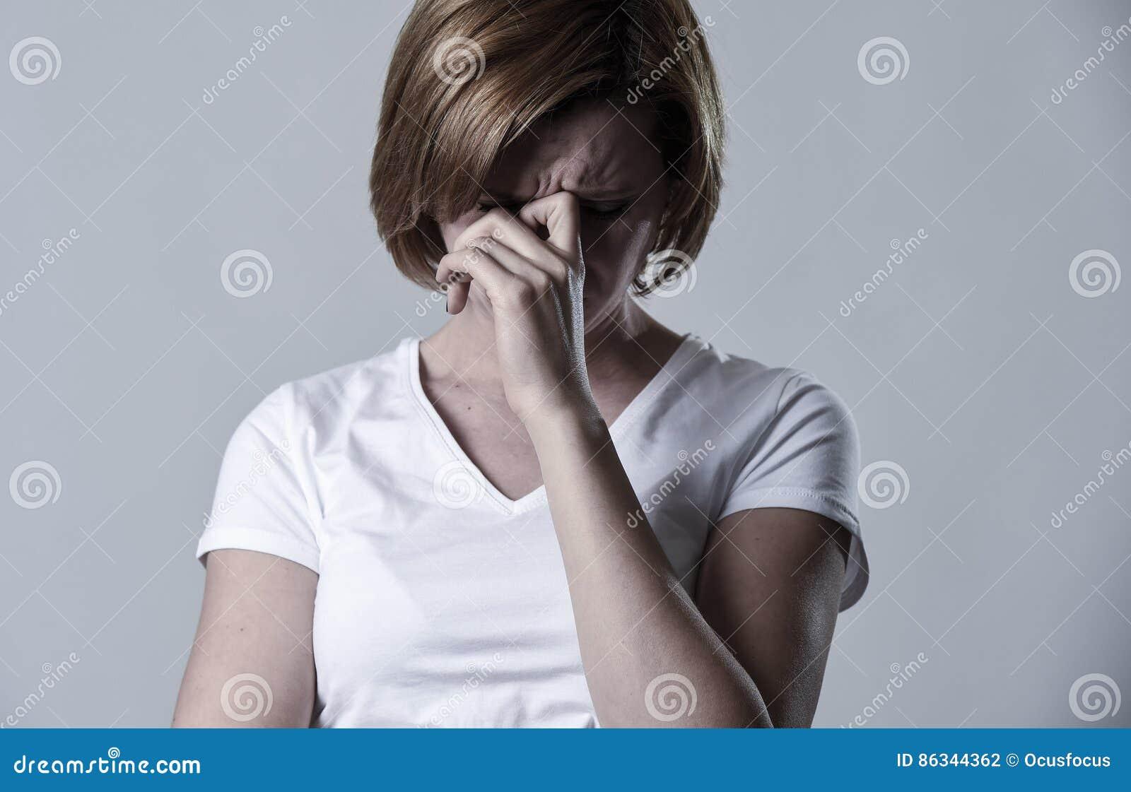 Devastated depressed woman crying sad feeling hurt suffering depression in sadness emotion