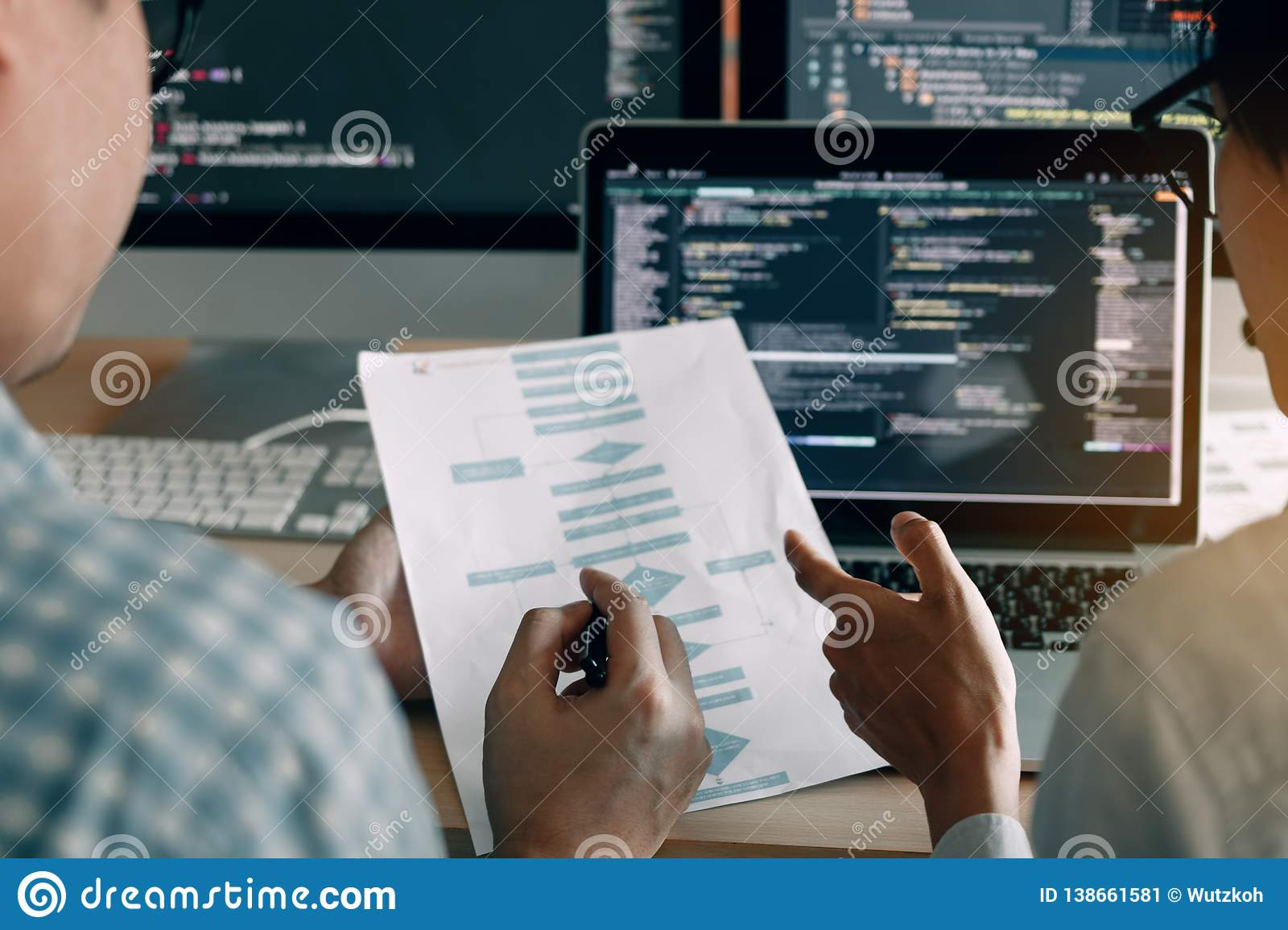 Developing programming and coding technologies working in a software engineers developing applications together in office