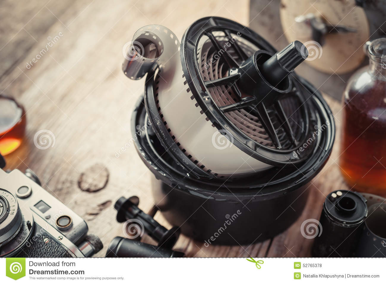 Developing tank with its film reels, photo film and camera