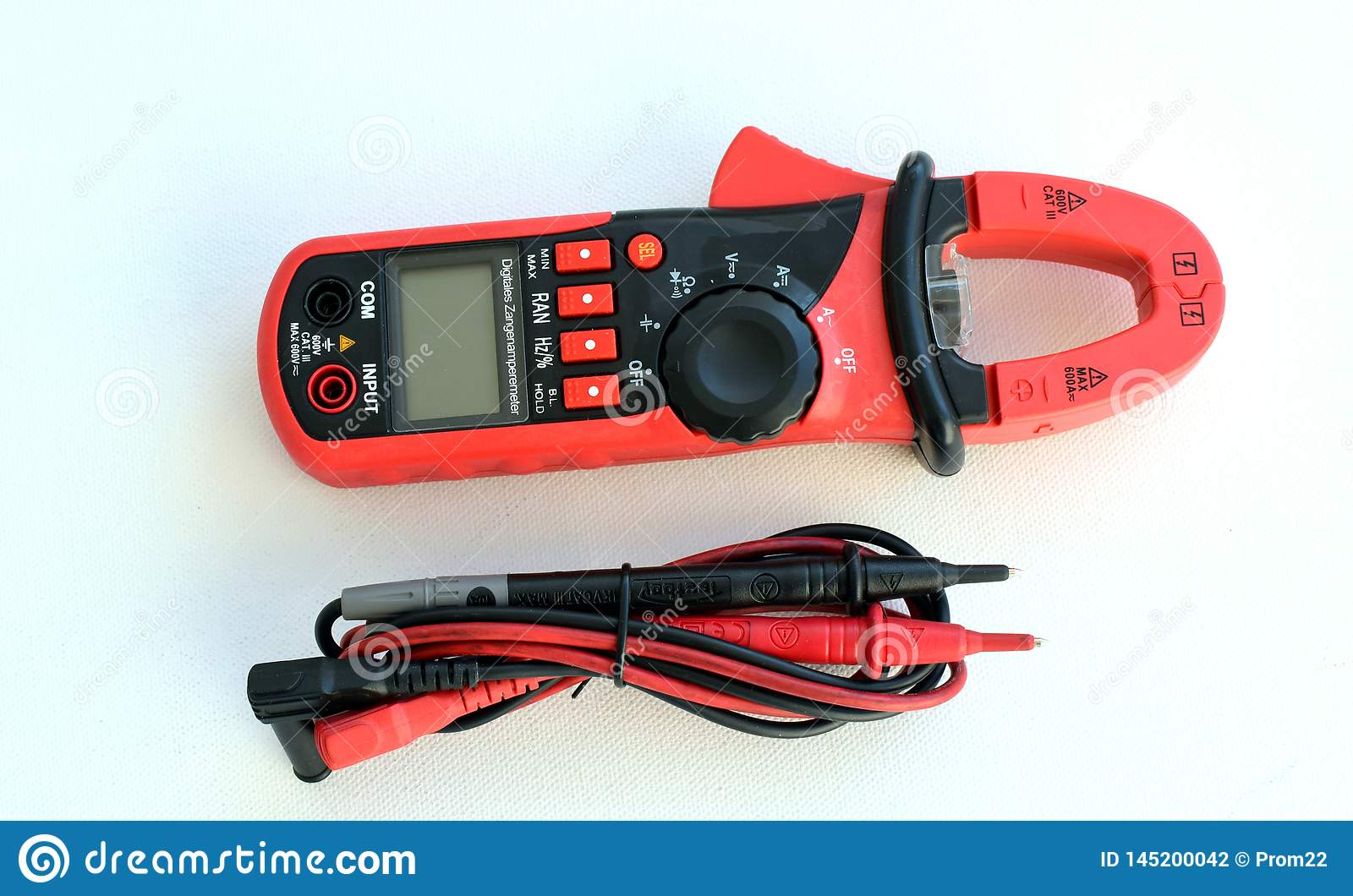 Device for measuring voltage in an electrical outlet with a multimeter on a white background. equipment, apparatus.