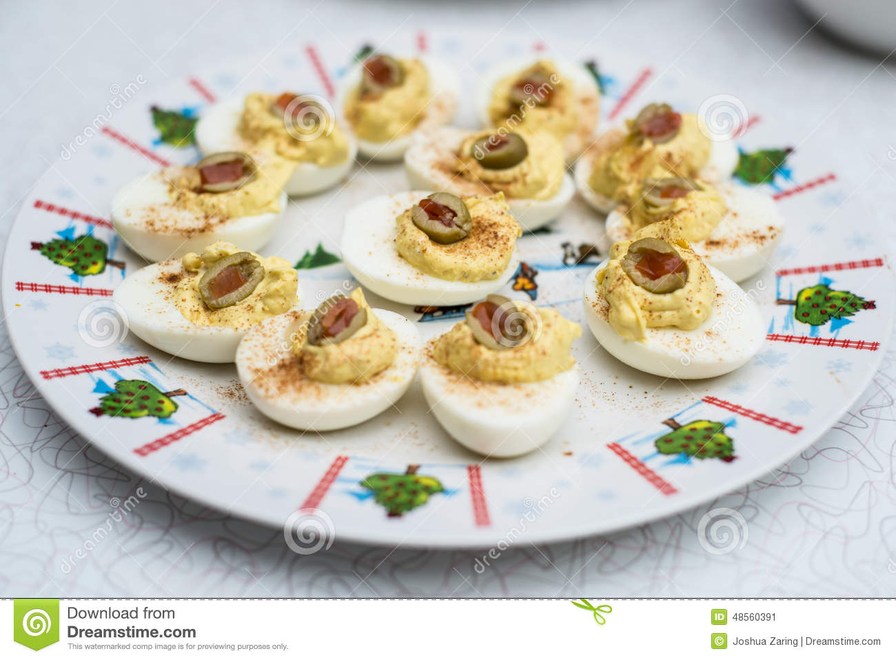 deviled eggs with olives on christmas platter - Christmas Deviled Eggs