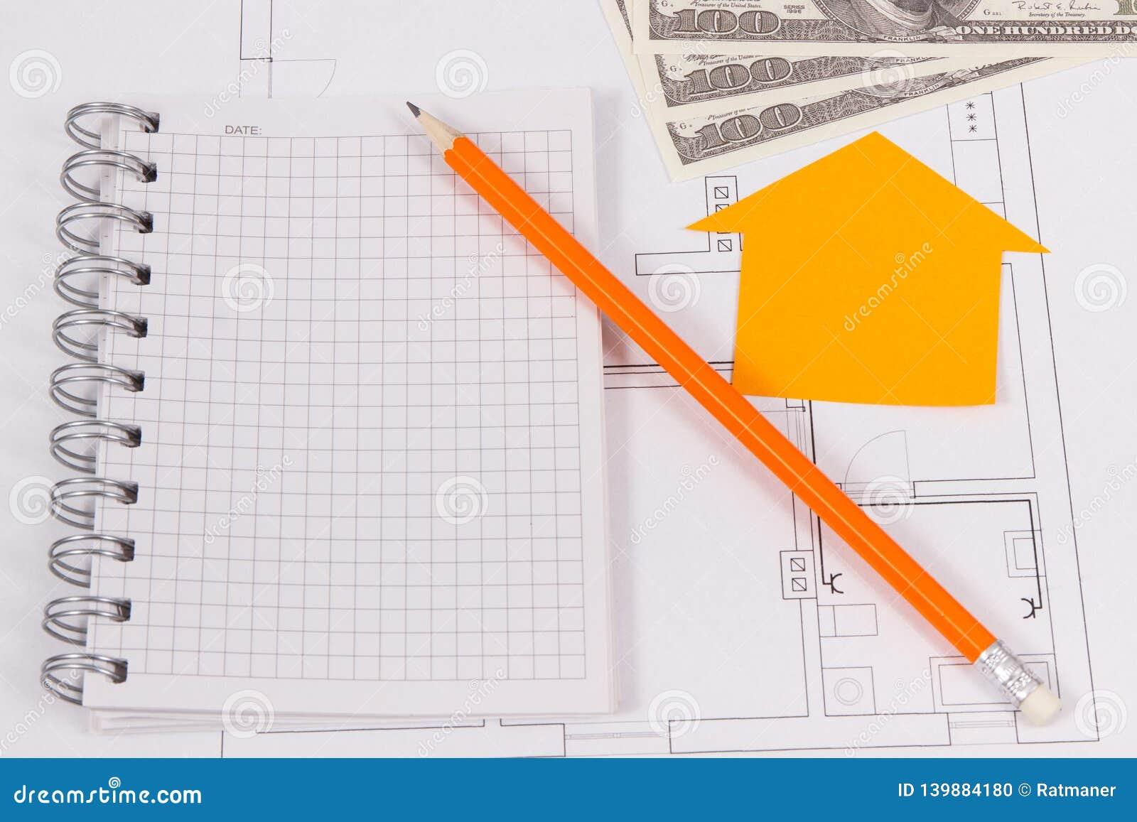 Devises dollar, bloc-notes et diagrammes électriques, louant ou vendant la maison ou le concept plat