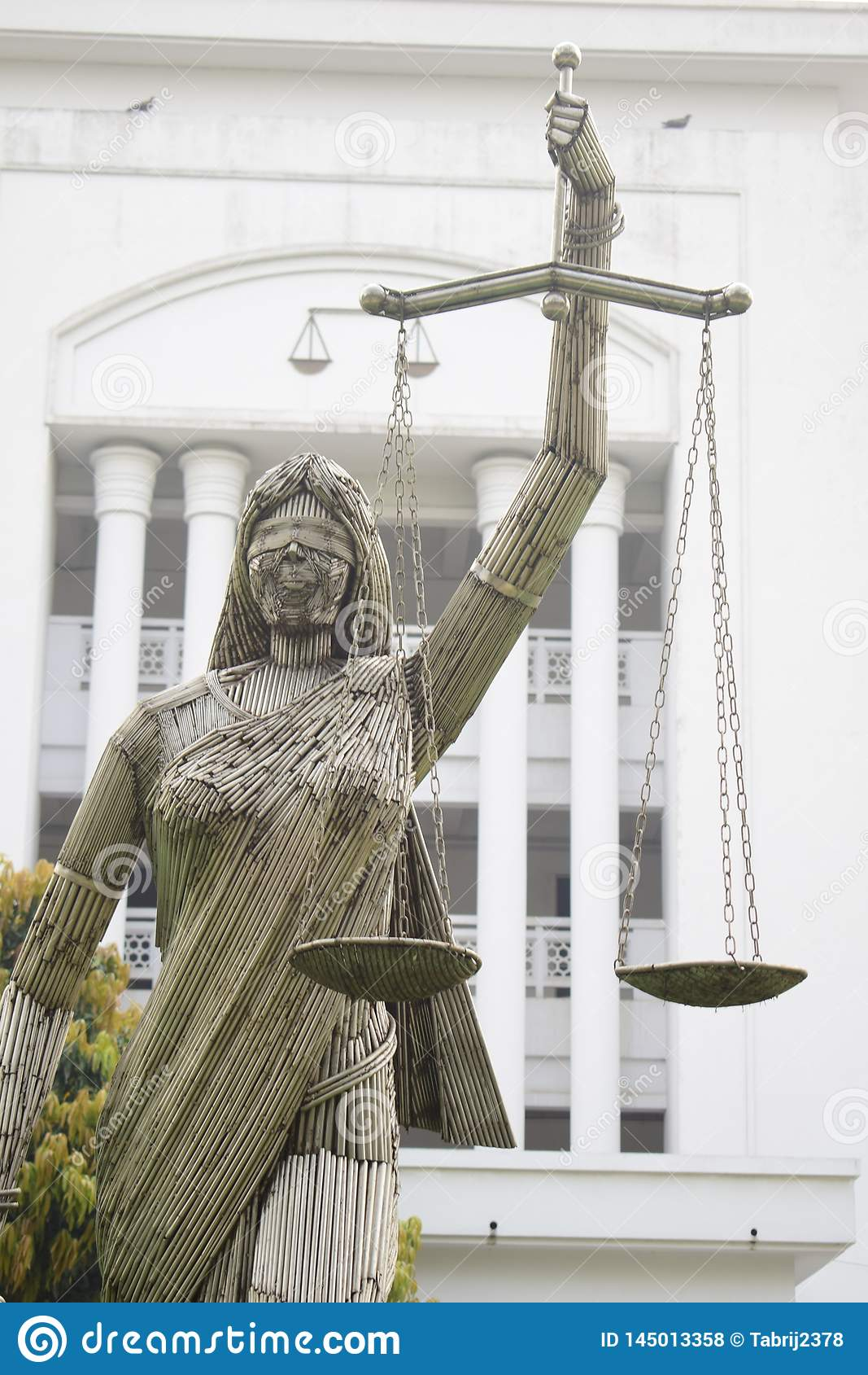 Dhaka, Bangladesh, -January, 21, 2019 : the iron made portrait of justice goddess themis in fron of supreme court
