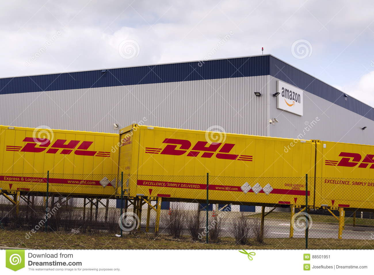 Dhl Shipping Containers In Front Of Amazon Logistics Building On