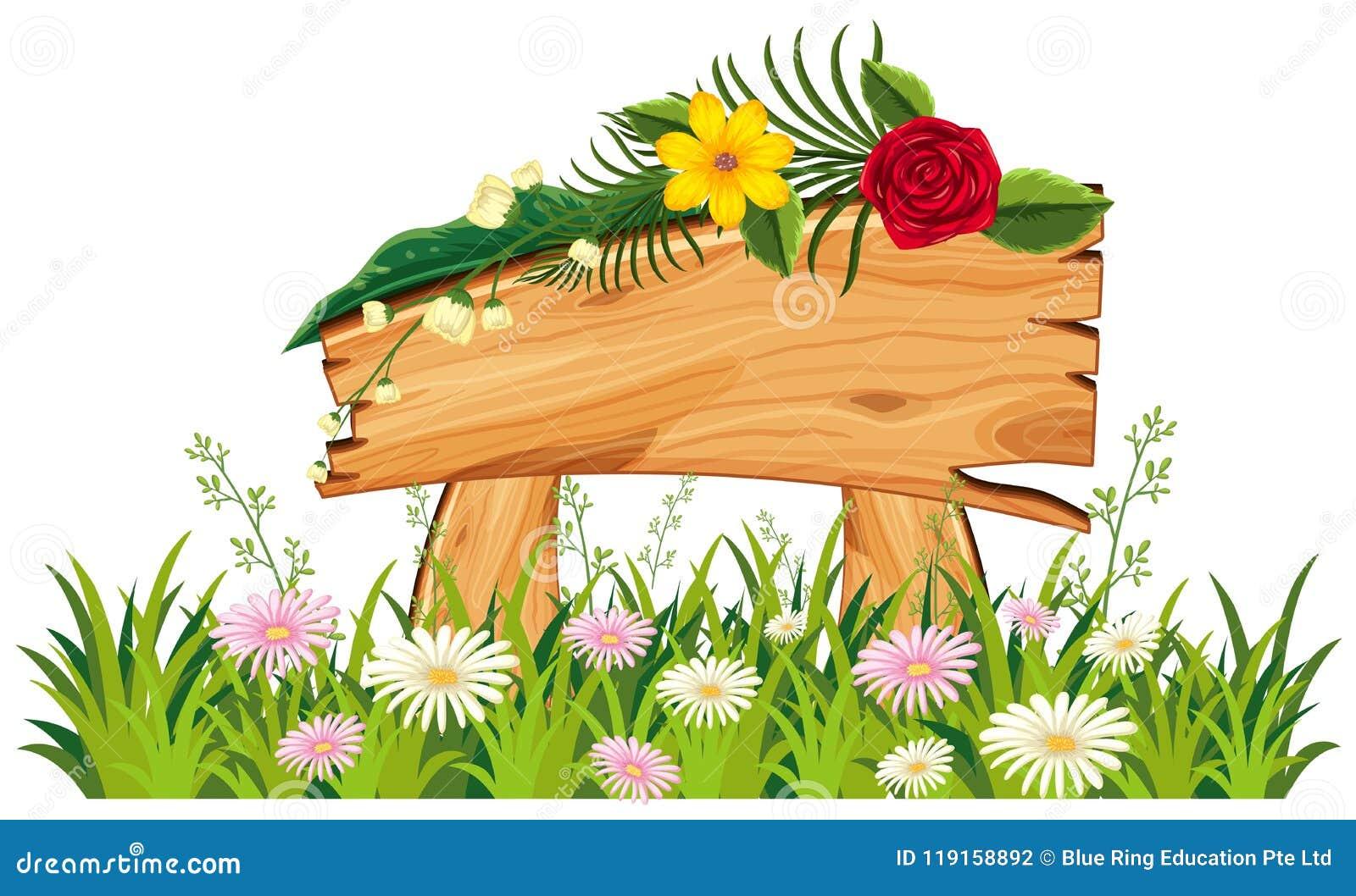 Di legno firmi dentro l erba con i fiori