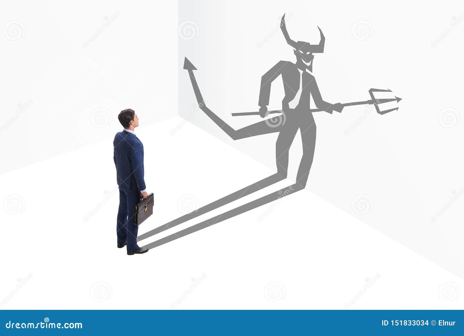 Diablo que oculta en el hombre de negocios - concepto del alter ego
