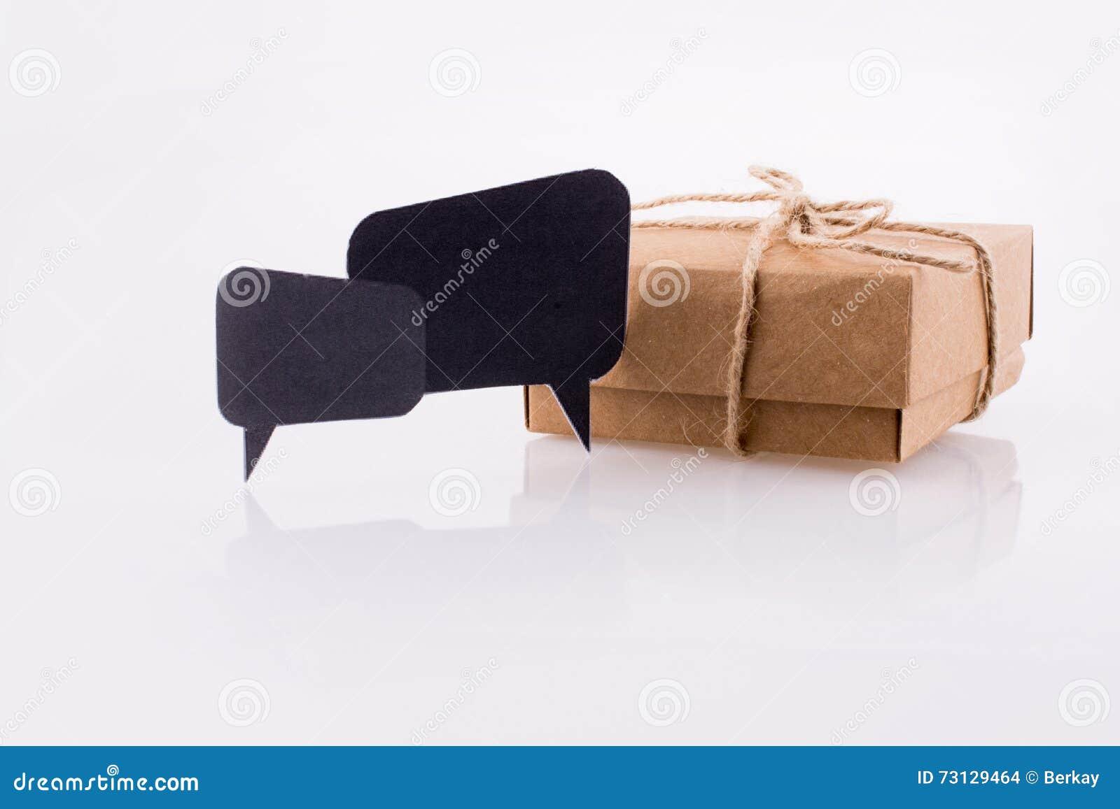 Dialogue boxes near a carton box