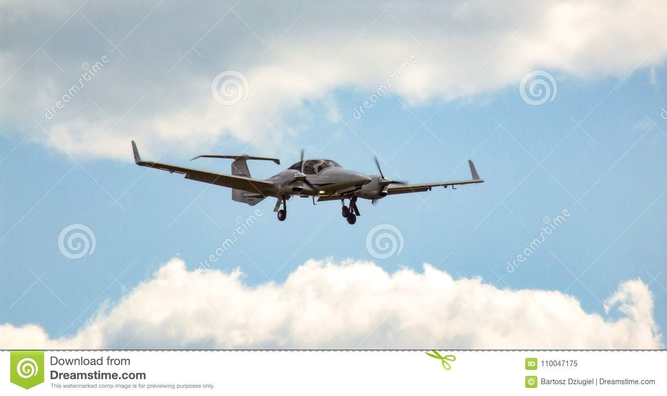 Twin Engine Piston Aircraft During Approach For Landing On Cloudy