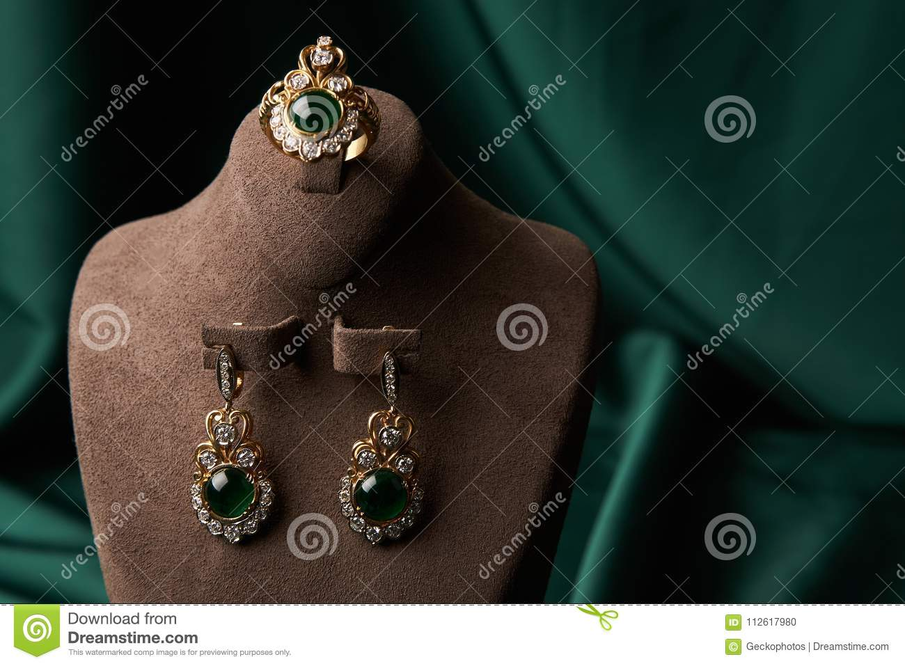 Diamond Ring And Earrings With Emerald On A Green Silk Background Luxury Female Jewelry Close Up