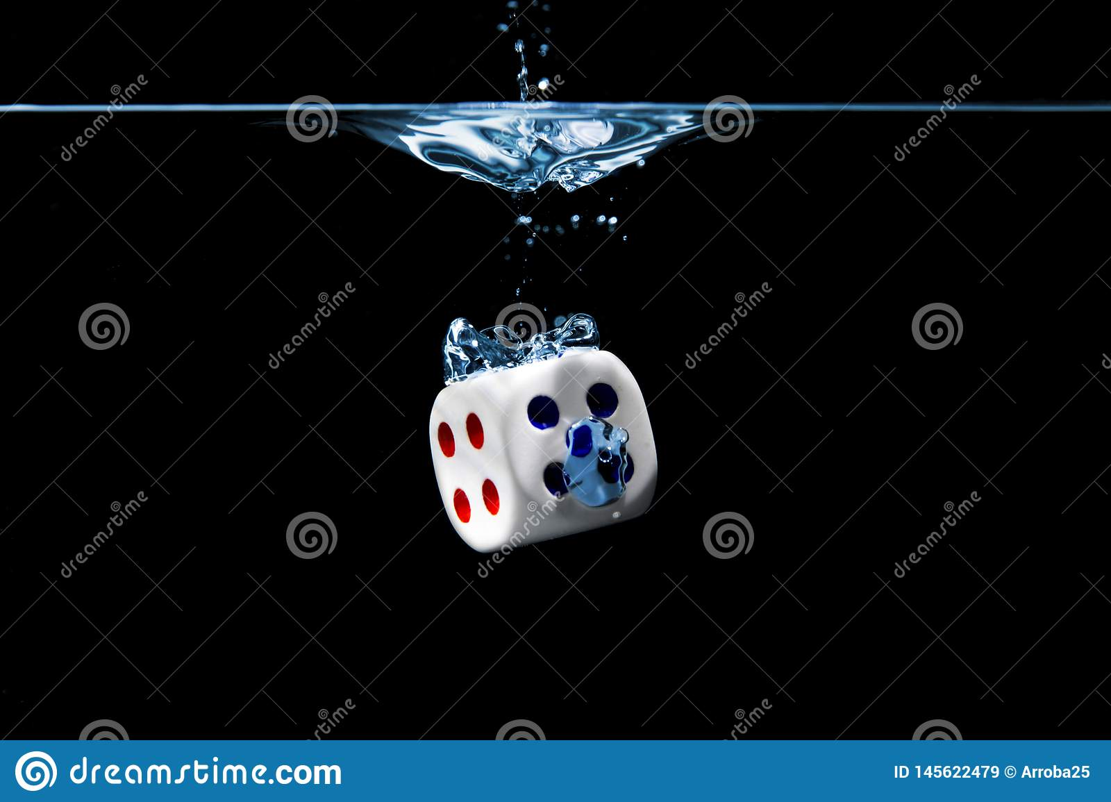Dice with the numbers four and five faces in the water with black background