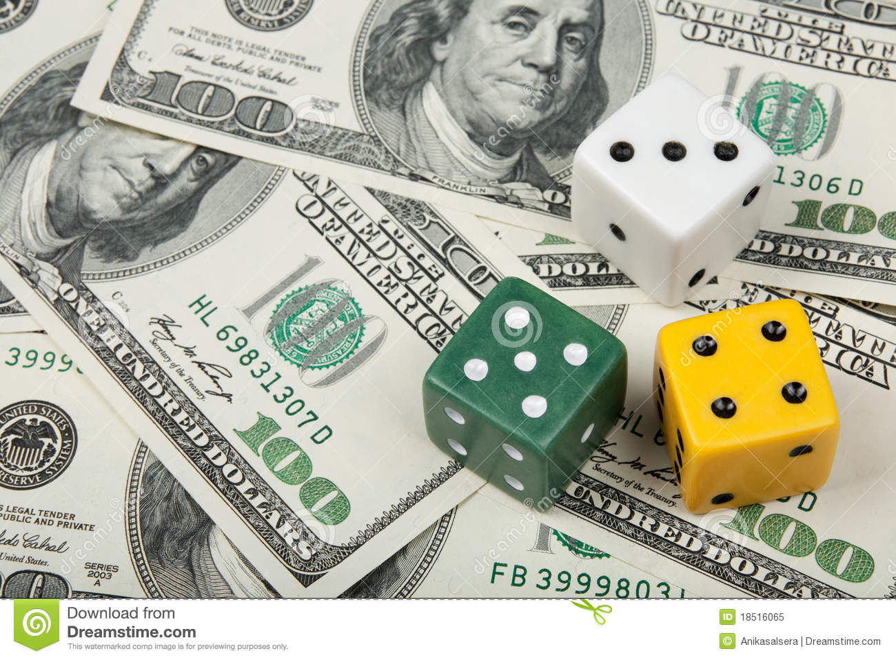 Dices of different colors on money background