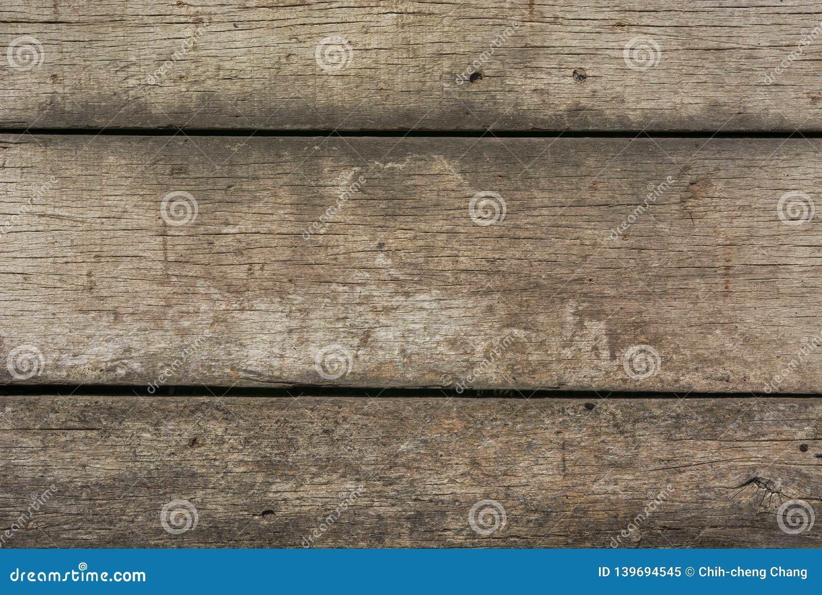 Die alte und gesprenkelte Holzbeschaffenheit