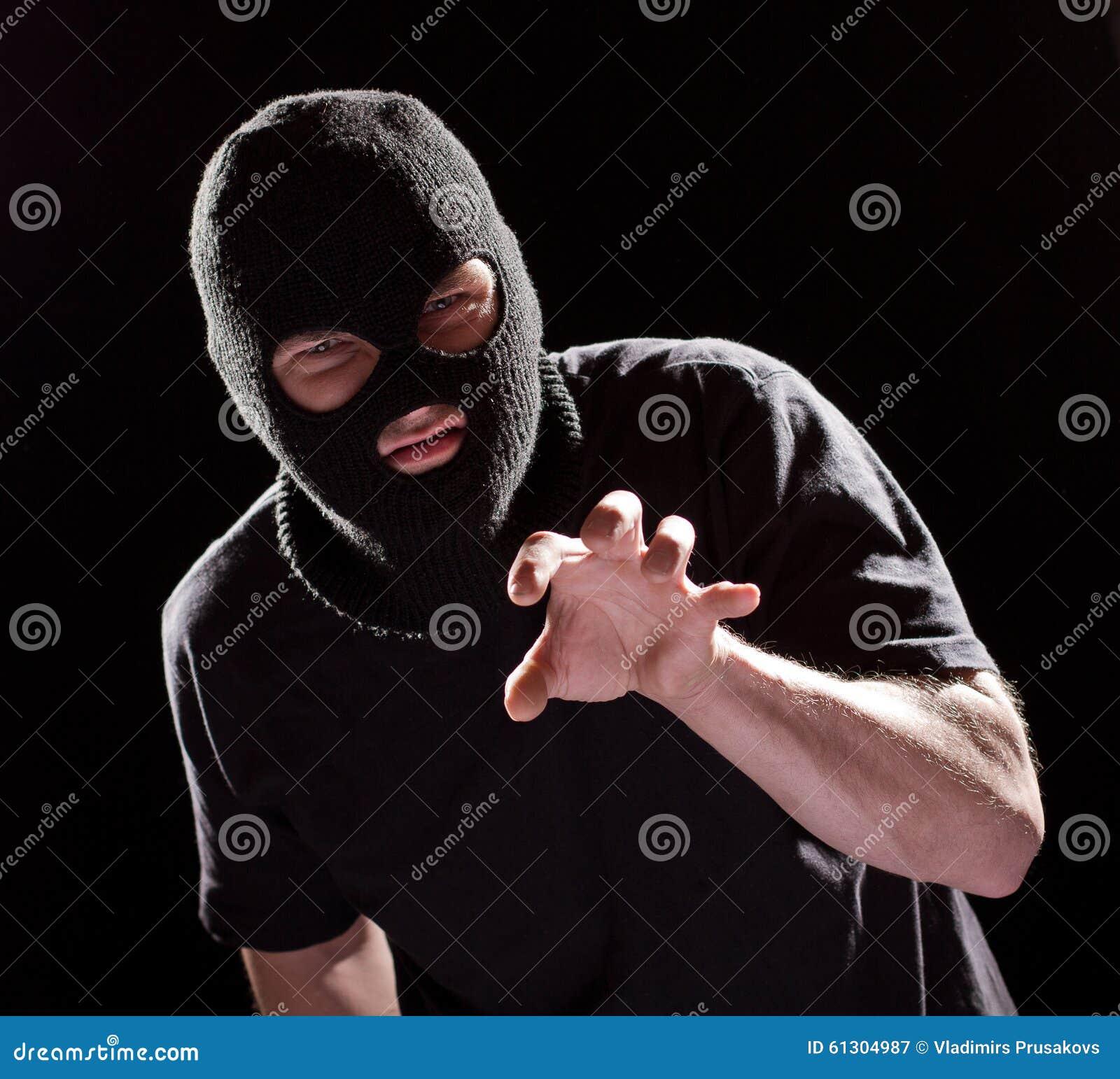 Dief Burglar die in Masker met de hand grijpen Misdaadmens in Zwarte