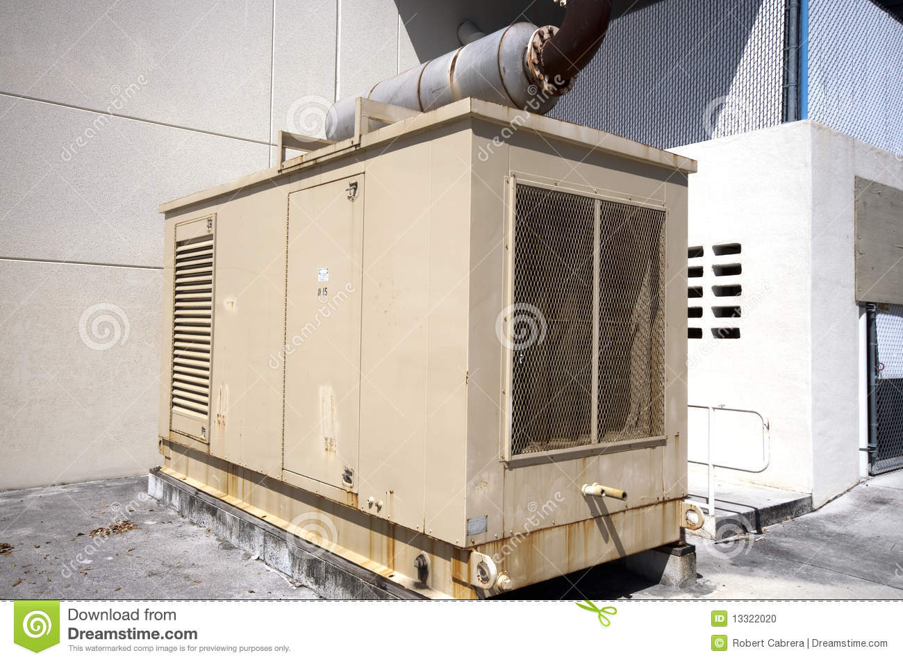Diesel powered stanby emergency Generator unit on the exterior of a  building ready in case of power failure 063d2baf57a