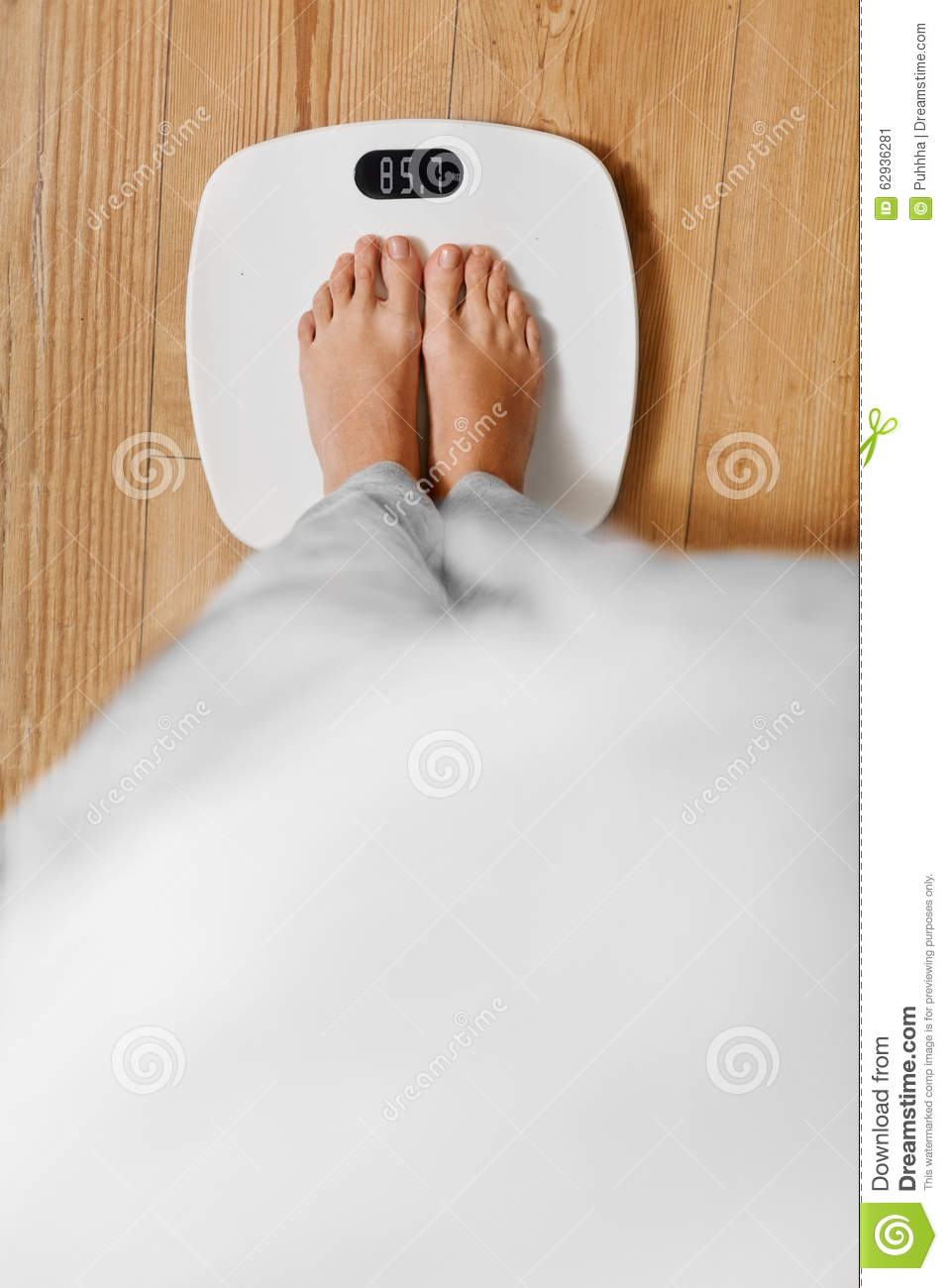 Diet. Female Feet On Weighing Scale. Weight Loss. Healthy Lifestyle.