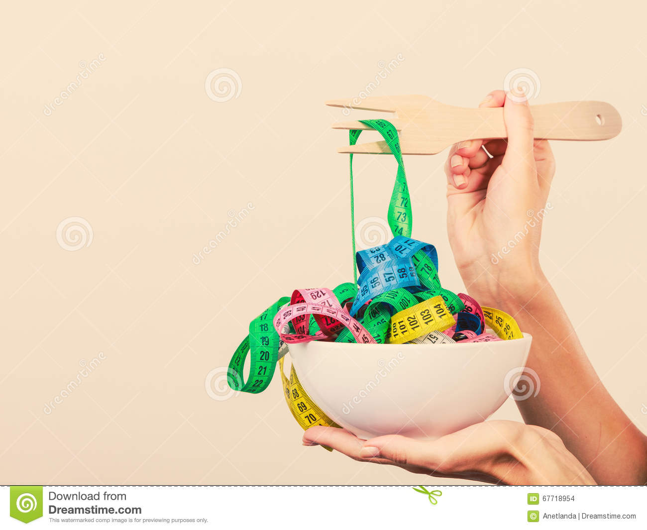 Diet. Human Hand And Measuring Tapes In Bowl Stock Photo ...